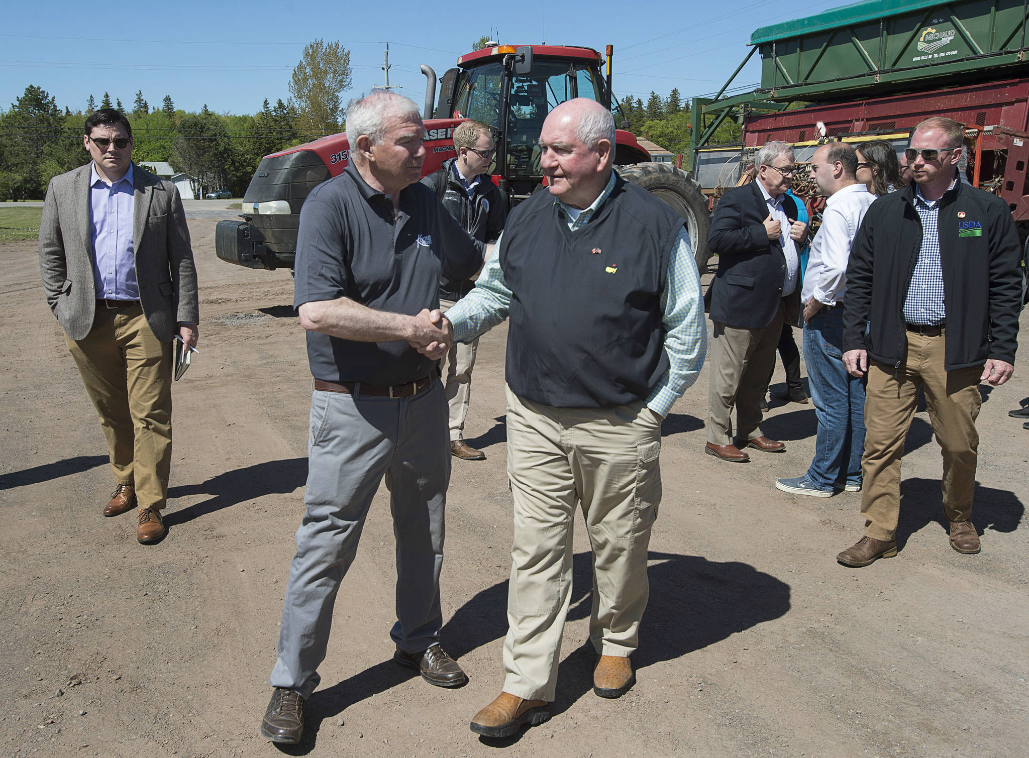 U.S. Secretary of Agriculture Sonny Perdue, right, shakes hands with owner Ray Keenan after touring Rollo Bay Holdings, which specializes in potato producing, marketing, shipping and exporting, in Souris, Prince Edward Island, Canada, on Friday, June 15, 2018. (Andrew Vaughan/The Canadian Press via AP)