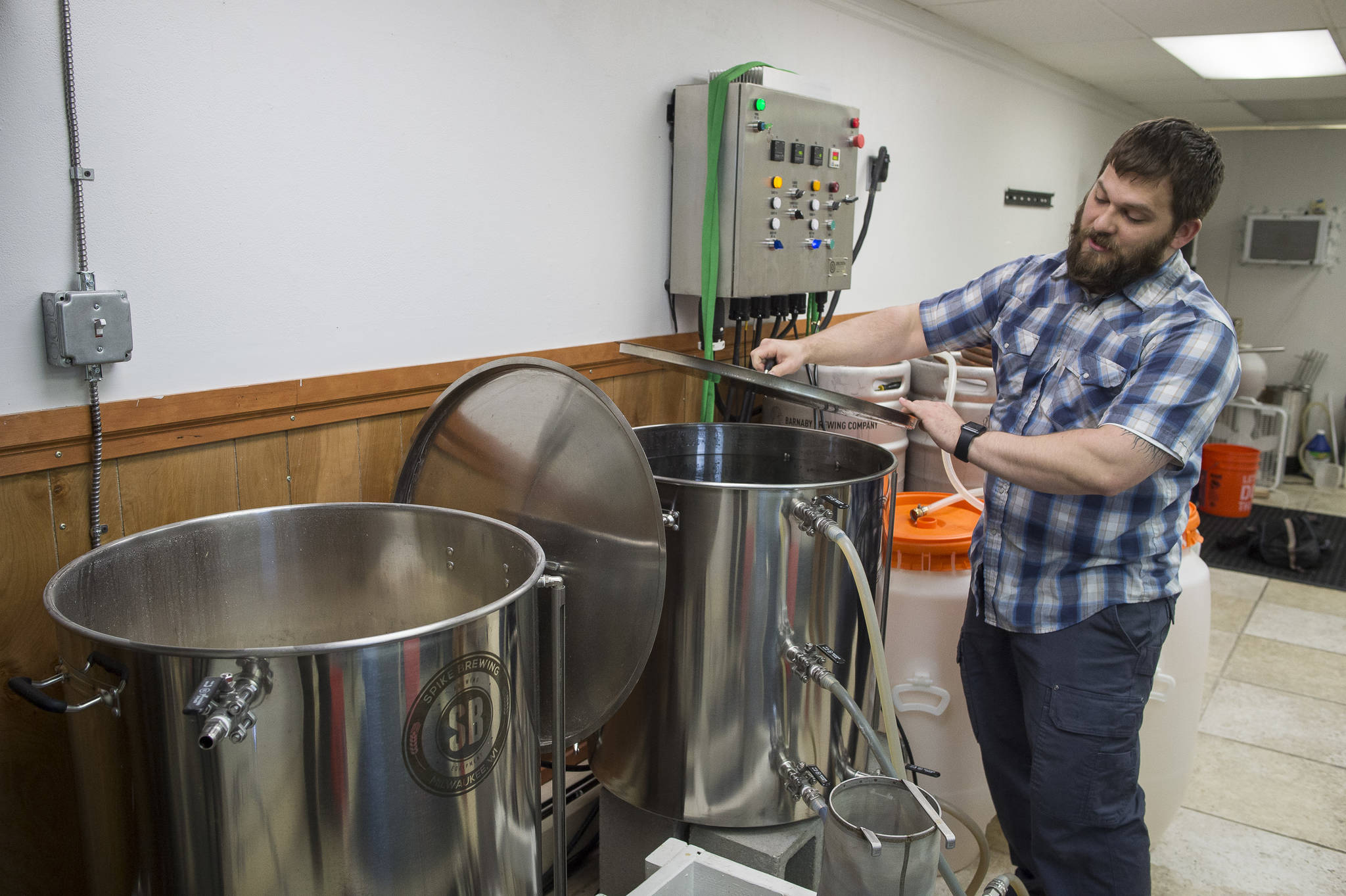"Matt Barnaby of Barnaby Brewing, talks about brewing a beer at his North Franklin location on Monday, April 9, 2018 before a fire closed the brewery. Barnaby recently won an award for its ""I'll Have Another 2018"" smoked beer. (Michael Penn 
