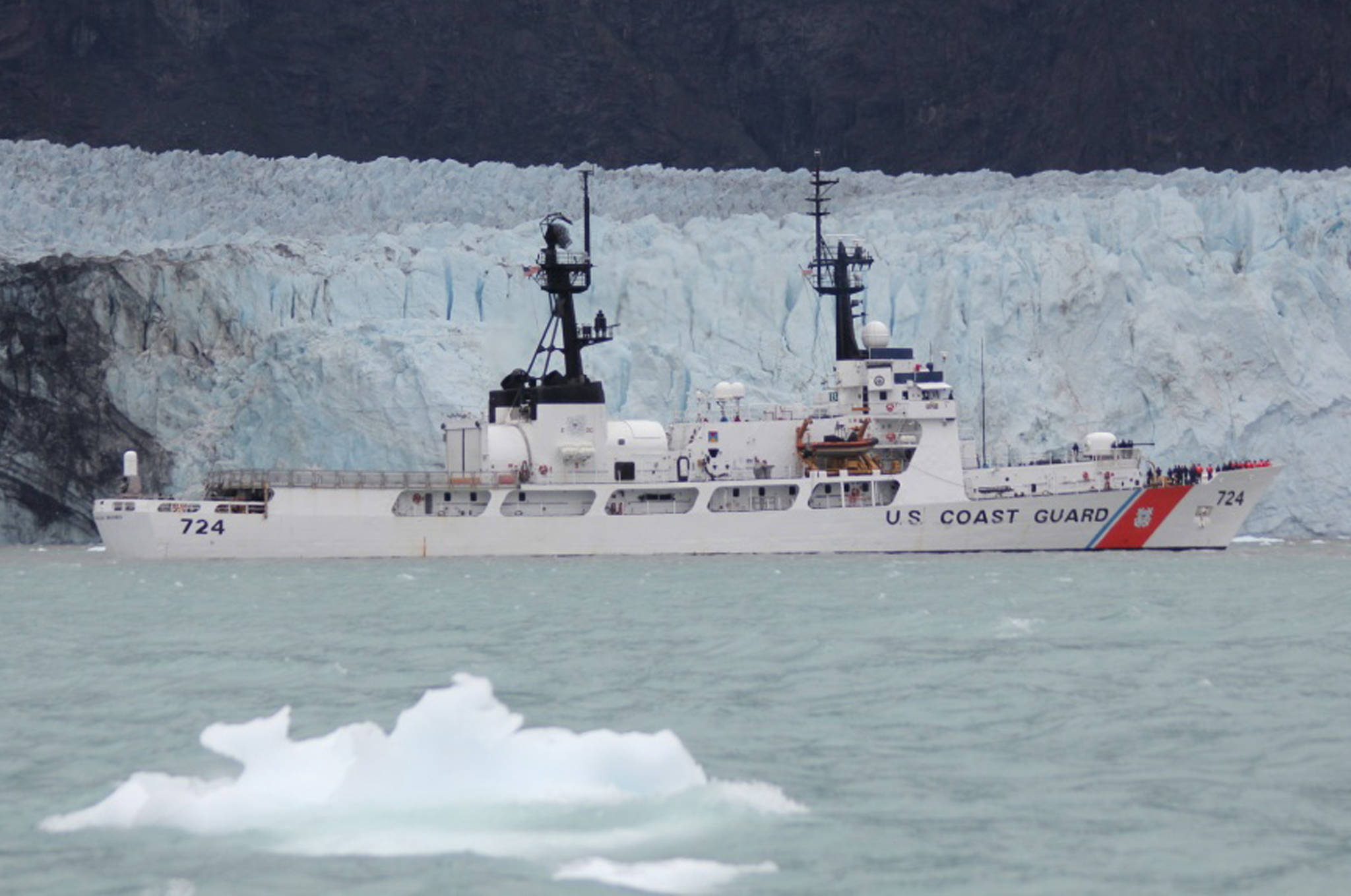 The Coast Guard Cutter Douglas Munro sails past Margerie Glacier in Glacier Bay National Park, Alaska, July 15, 2018. The Douglas Munro crew assisted the Glacier Bay National Park Service personnel in rescuing four people whose kayaks overturned in rough waters, but all four people made it to shore. (U.S. Coast Guard | Courtesy Photo)