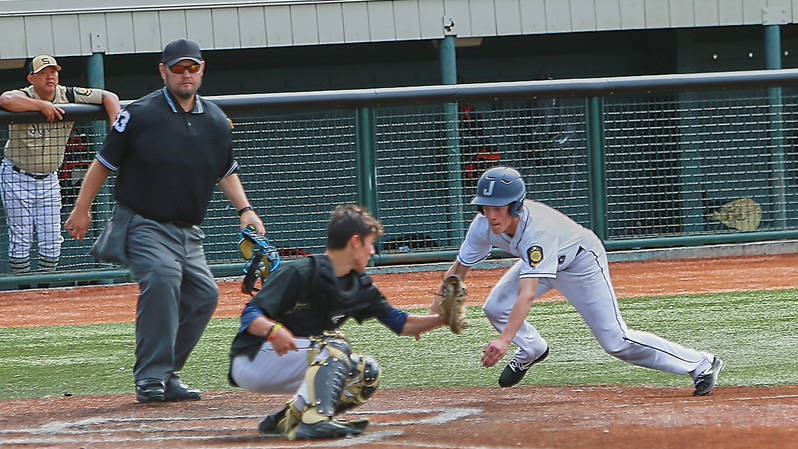 Juneau Post 25 shortstop Zeb Storie slides into home plate against South Post 4 in the American Legion state tournament at Mulcahy Stadium in Anchorage on Saturday. Juneau won 6-3. (Courtesy Photo | Jeremy Ludeman)