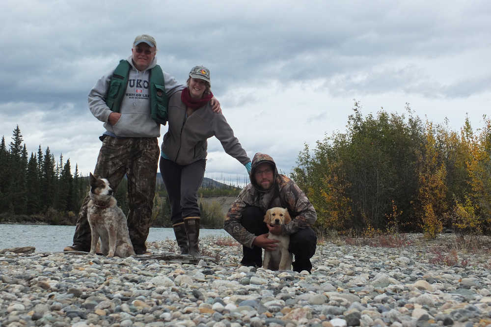 From left to right, Loki, Nils Dihle, Mary Catharine Martin, Bjorn Dihle and Fen pause for a photo shortly after shooting some rapids on the Big Salmon River.