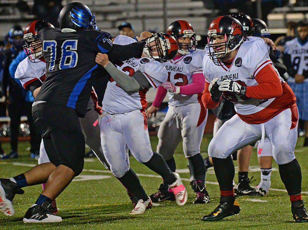 Last season the Glacier Bowl highlighted Thunder Mountain interior lineman Meki Sikione (76), at left, selected to the 2014 Southeast Conference first team on defense and Juneau-Douglas offensive tackle Nick Tragis, far right, an SEC offensive team choice.