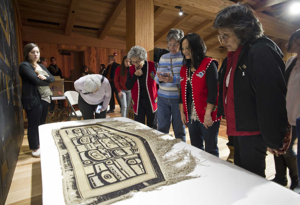 People attending a public ceremony Tuesday at the Walter Soboleff Center get a close up view of a Chilkat robe recently acquired on eBay by the Sealaska Heritage Institute.