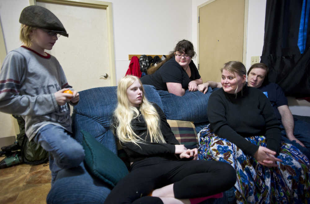 """After falling on hard times and living out of a tent at the Mendenhall Campgrounds a few years ago, Apryle and Shannon McVey, and their chidren, Arthur, 13, Carrie, 14, Katie, 17, have found stable, affordable housing through Saint Vincent de Paul. SVDP is hoping more Juneau residents will participate in its annual """"Adopt A Family"""" holiday program which makes sure children staying at the shelter have presents under the Christmas tree."""