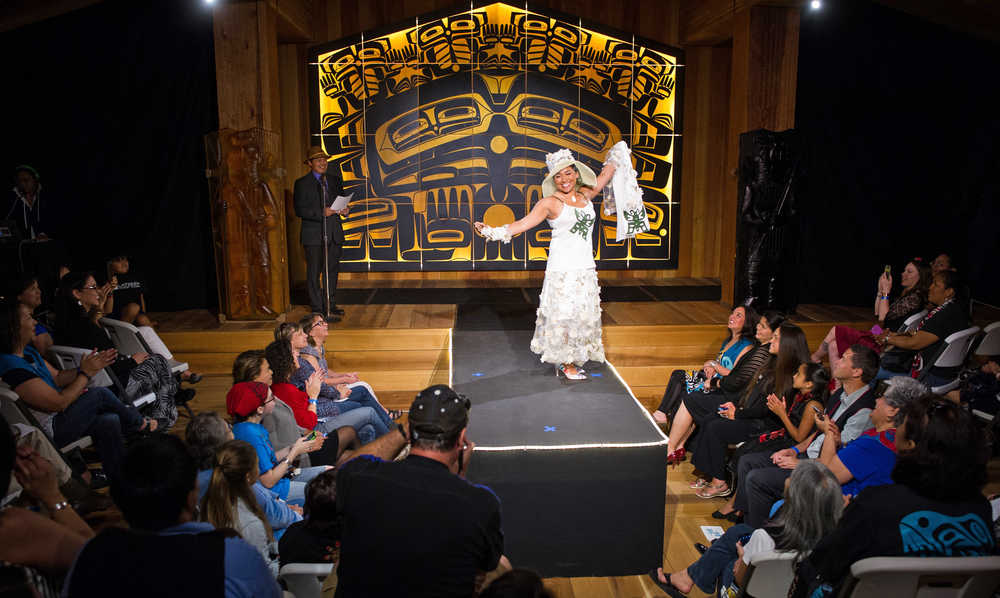 Majorie Taabone models a dress by Maria Shaa Tlaa during the Celebration 2016 Native Fashion Show in the Shuka Hit Clan House at the Walter Soboleff Center on Friday.