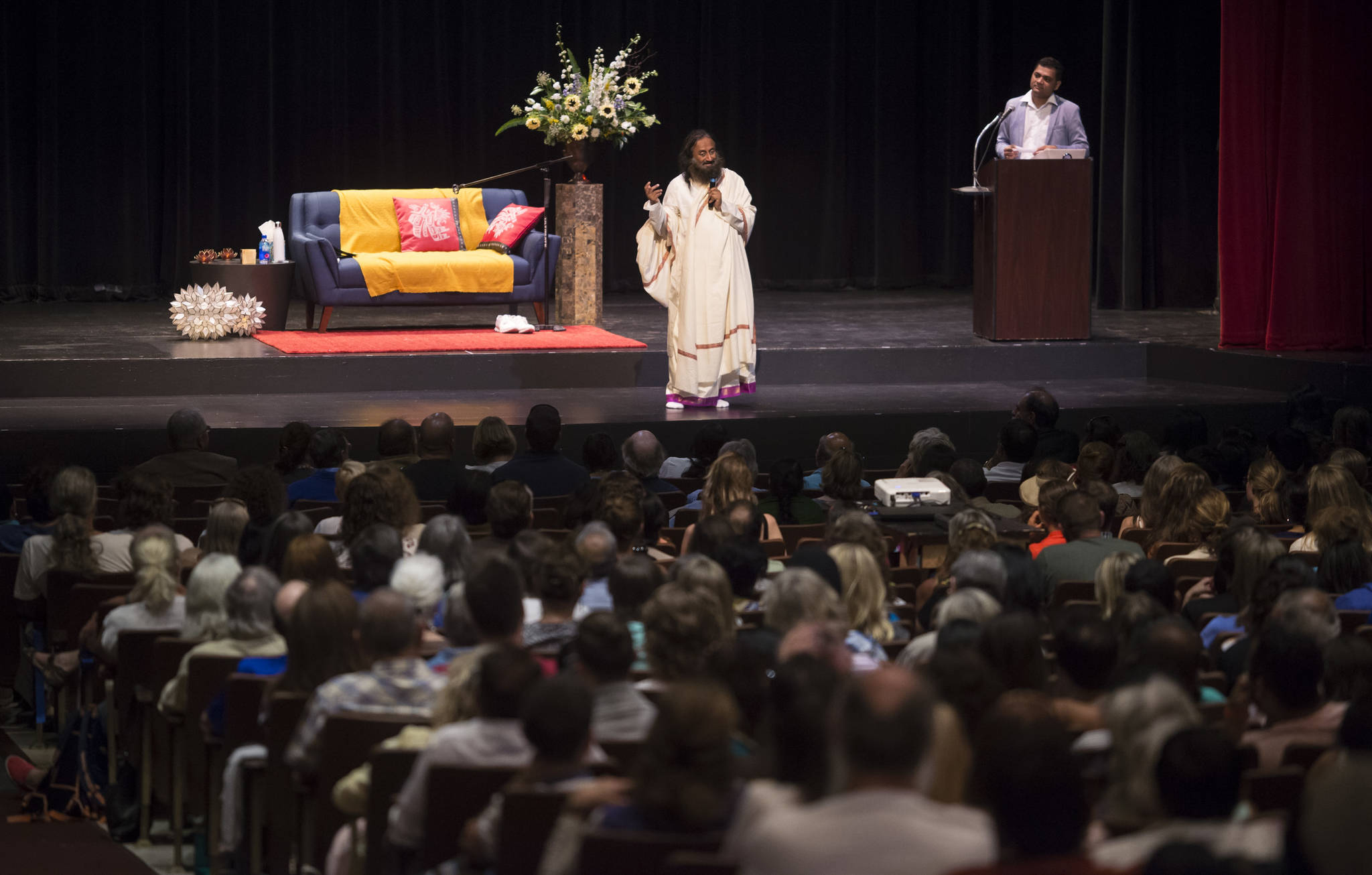 Spiritual leader Sri Sri Ravi Shankar of The Art of Living Foundation leads a group meditation at the Juneau-Douglas High School auditorium on Tuesday, July 31, 2018, as part of his West Coast Tour that also includes San Francisco and Seattle. (Michael Penn | Juneau Empire)