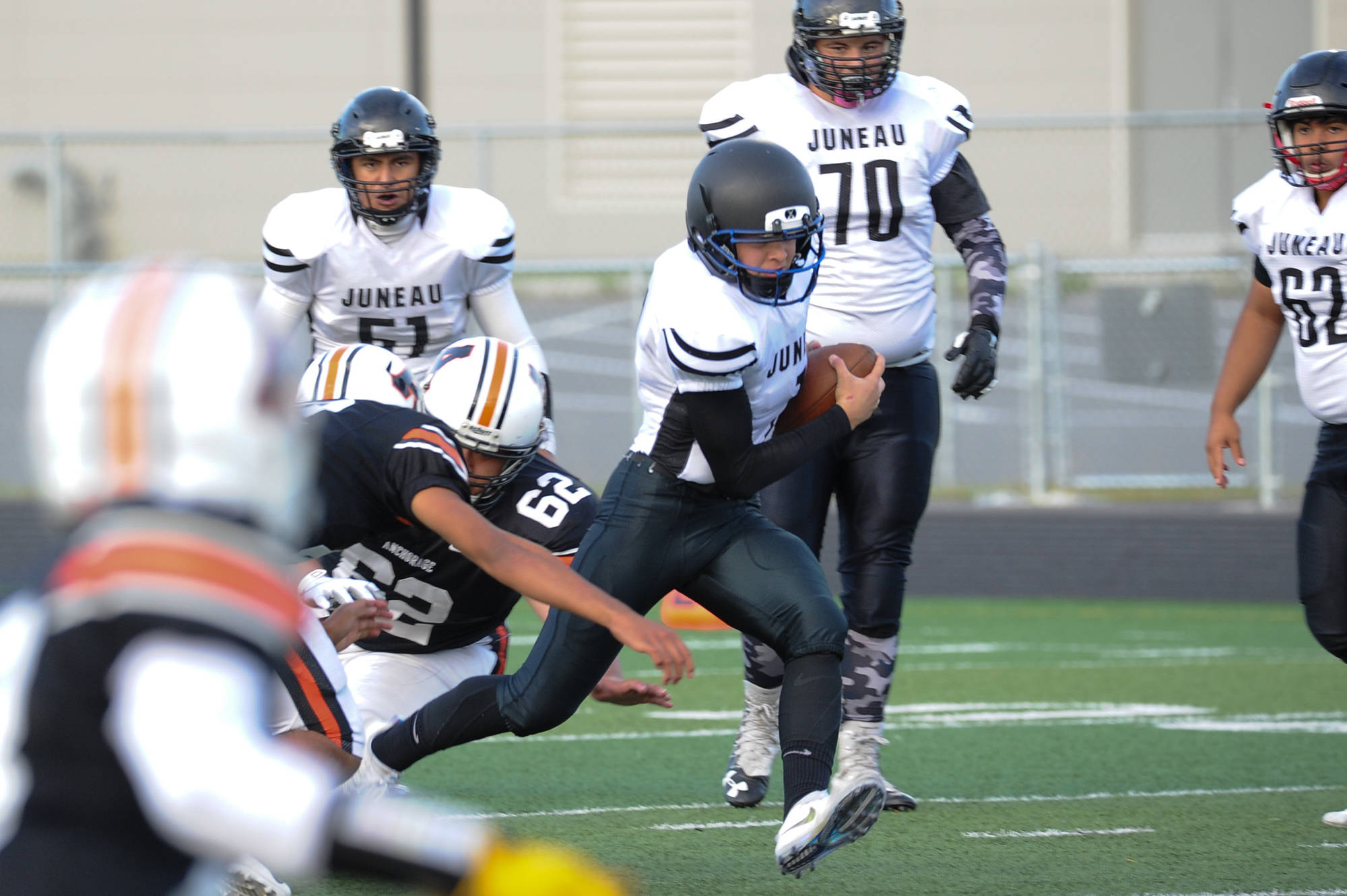 Juneau's Thomas Willhoite finds a hole in the West defense. (Michael Dinneen | For the Juneau Empire)