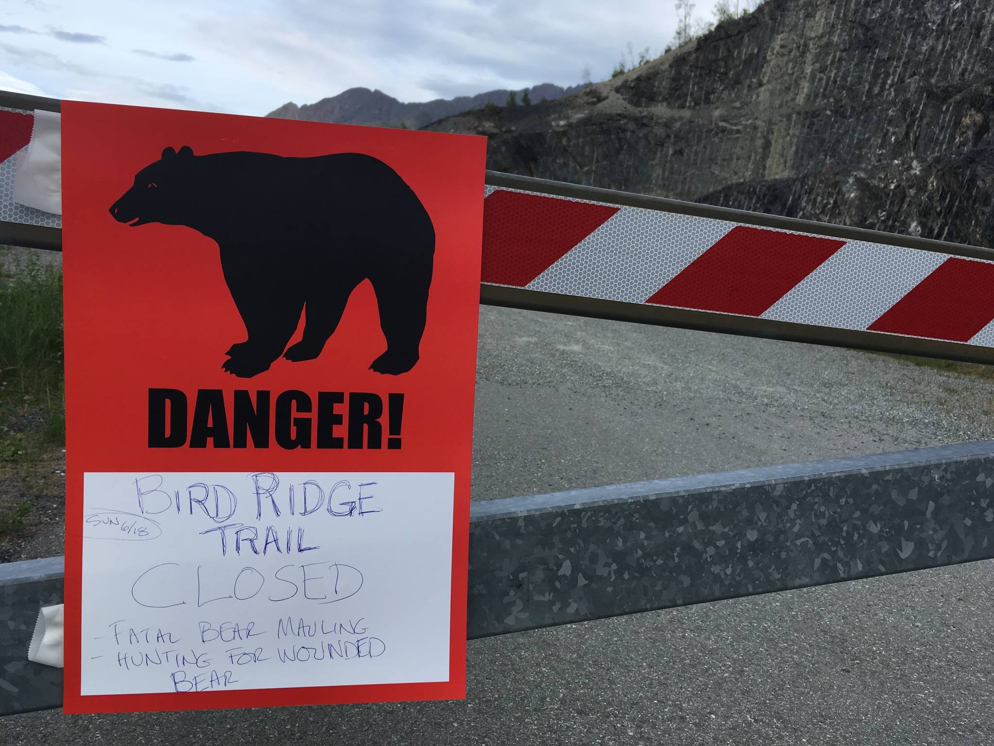 A sign warns people that the trail head is closed on Monday, June 19, 2017, after a fatal bear mauling at Bird Ridge Trail in Anchorage, Alaska. Authorities say a black bear killed a 16-year-old runner while he was competing in an Alaska race on Sunday. (Mark Thiessen   The Associated Press)