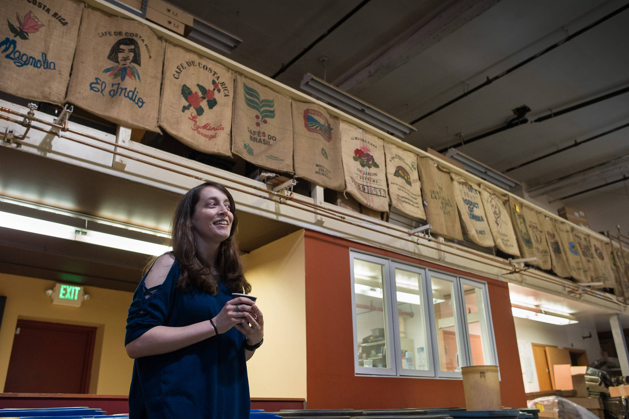Amy Knight talks about her new ownership of Heritage Coffee at their downtown office and roasting facility on Thursday, Aug. 31, 2017. (Michael Penn | Juneau Empire)
