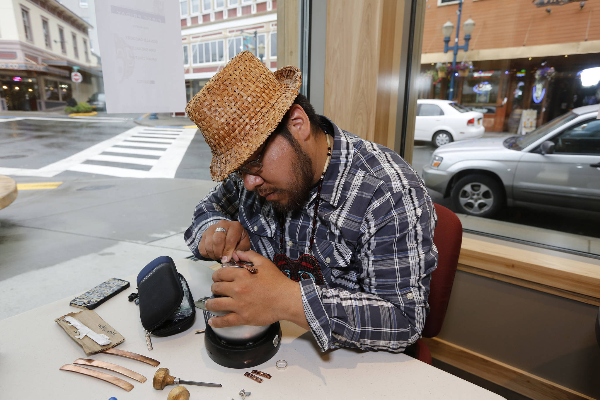 Samuel Sheakley, one of SHI's featured artists for First Friday, works on a piece of jewelry. Photo by Brian Wallace.