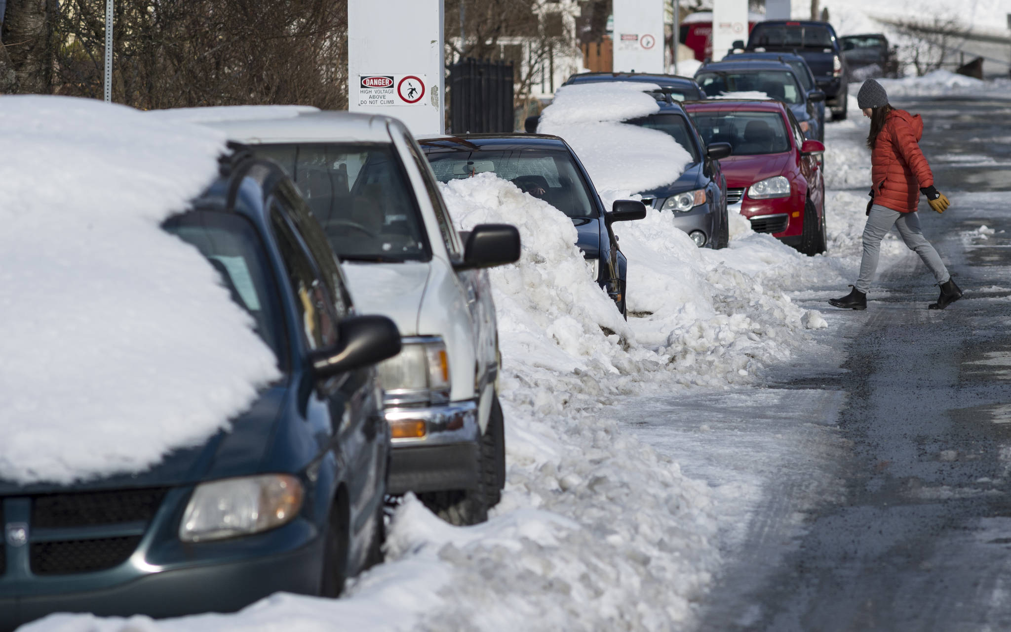 Parked vehicles and piles of snow line 11th Street on Thursday, March 1, 2018. February was cold and the forecast for March is for more of the same. (Michael Penn | Juneau Empire)