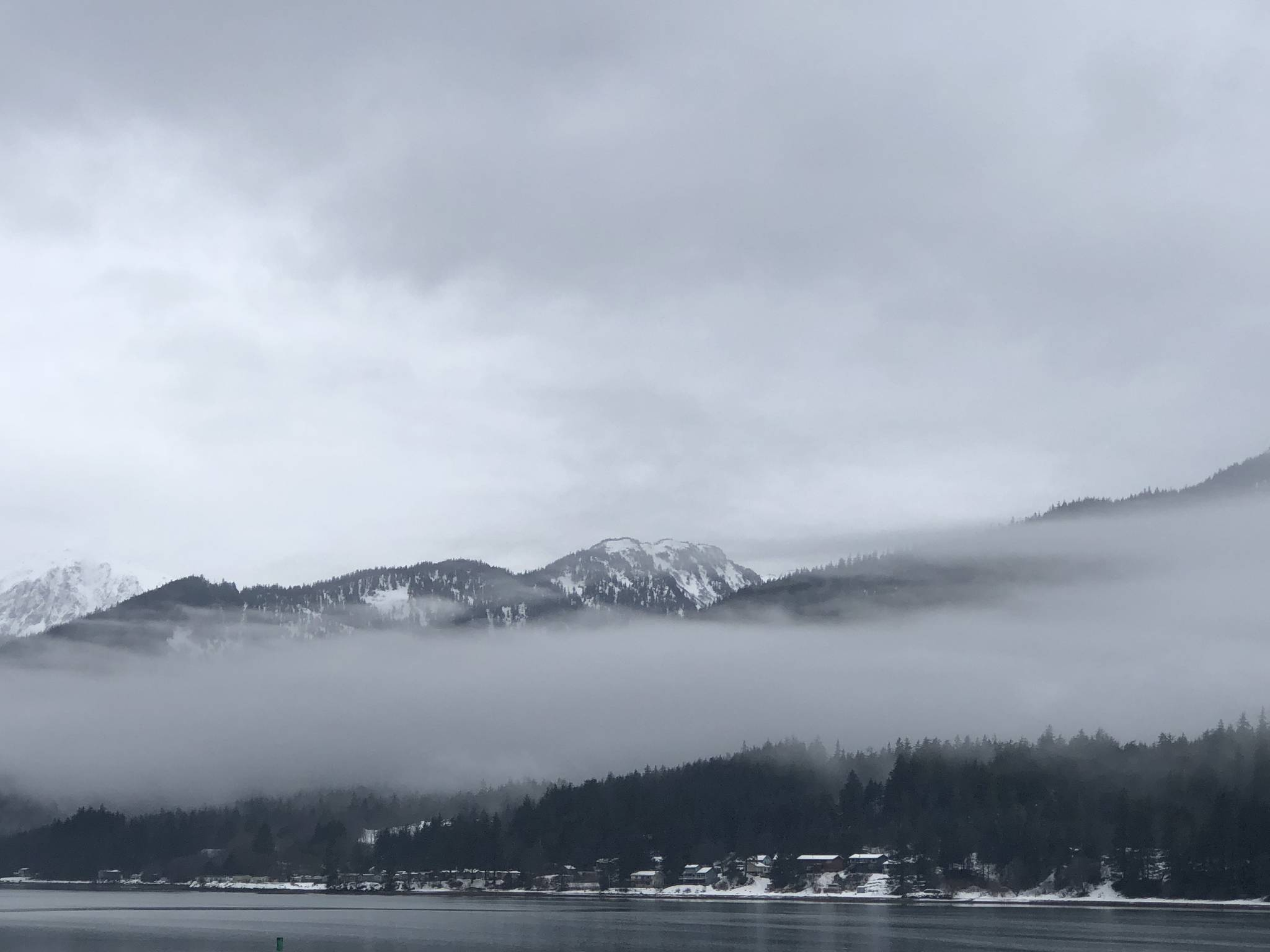 Fog is seen on Douglas Island Monday morning. Temperatures are expected to reach 50 degrees Tuesday for the first time this year and rapidly erode Juneau's remaining sea-level snow. (Juneau Empire)  Fog is seen on Douglas Island Monday morning. Temperatures are expected to reach 50 degrees Tuesday for the first time this year and rapidly erode Juneau's remaining sea-level snow. (Juneau Empire)