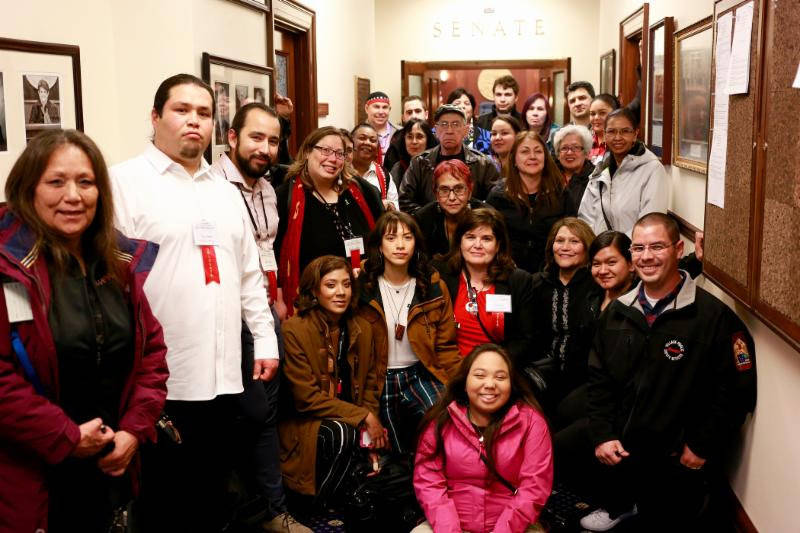 Participants in the Central Council of Tlingit and Haida Indian Tribes of Alaska's 83rd annual Tribal Assembly pose in the Alaska Legislature on April 19, 2018 after breaking from the assembly to testify on House Concurrent Resolution 19. (Courtesy photo)