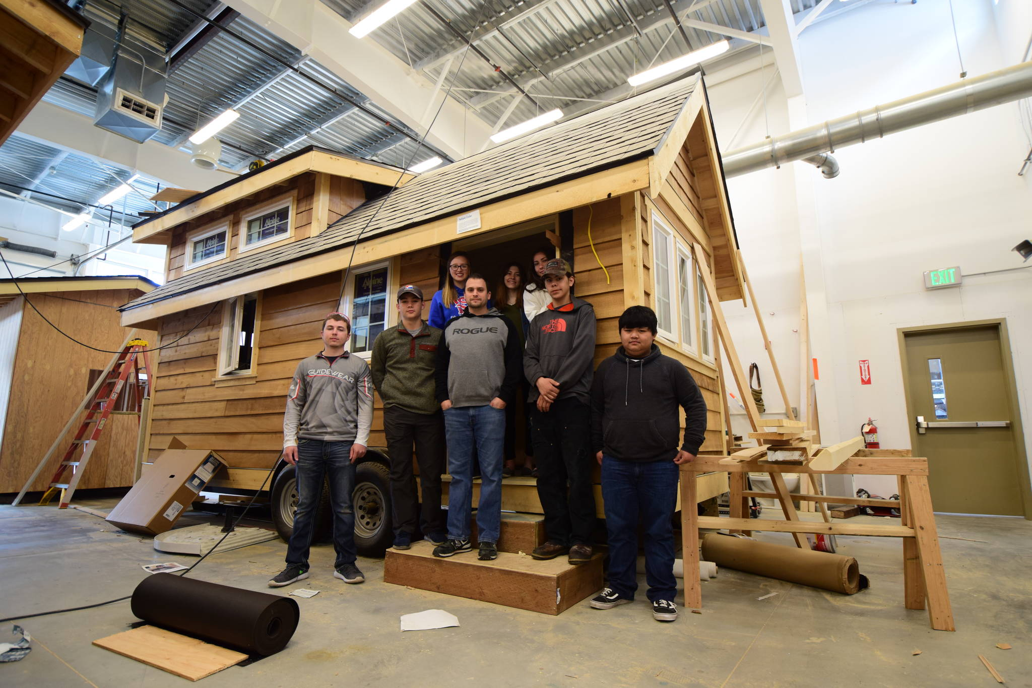 Teacher Mike Vieira and students in Sitka High's Advanced Construction class with the Tongass Tiny Home they helped build. Maia Mares | For the Capital City Weekly