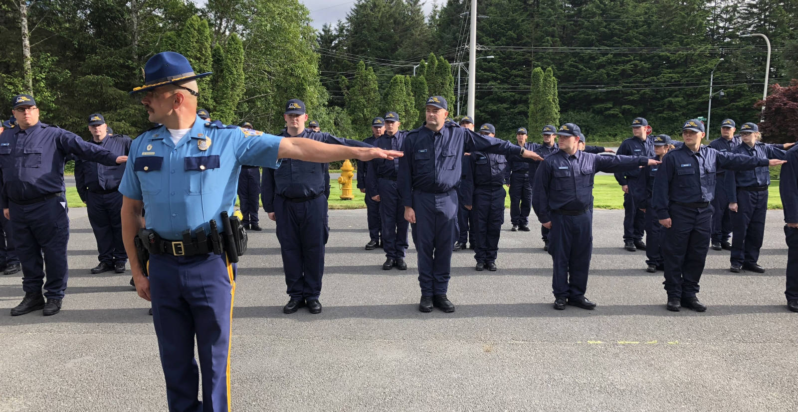Sgt. Eric Spitzer, deputy commander of the Alaska Law Enforcement Training Academy, leads recruits in training exercises on July 30, 2018, the first day of training at the Public Safety Training Academy in Sitka, Alaska. (Alaska State Troopers photo)