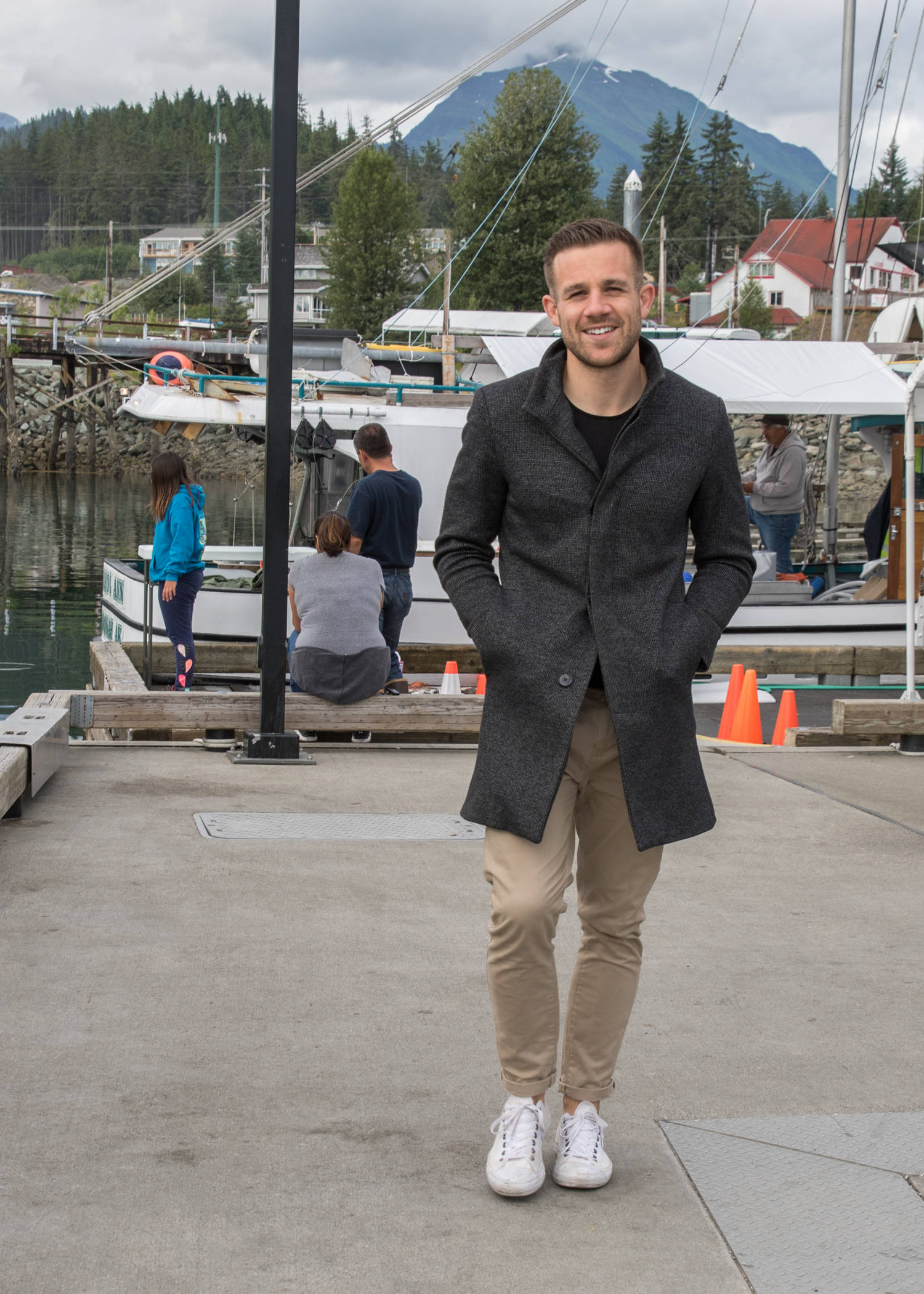 Style doesn't have to be complicated. Matt Weighman, a visitor from the UK, keeps it simple by wearing a woven grey Zara Man jacket over a black T-shirt and slim-fit khaki jeans with rolled up cuffs.