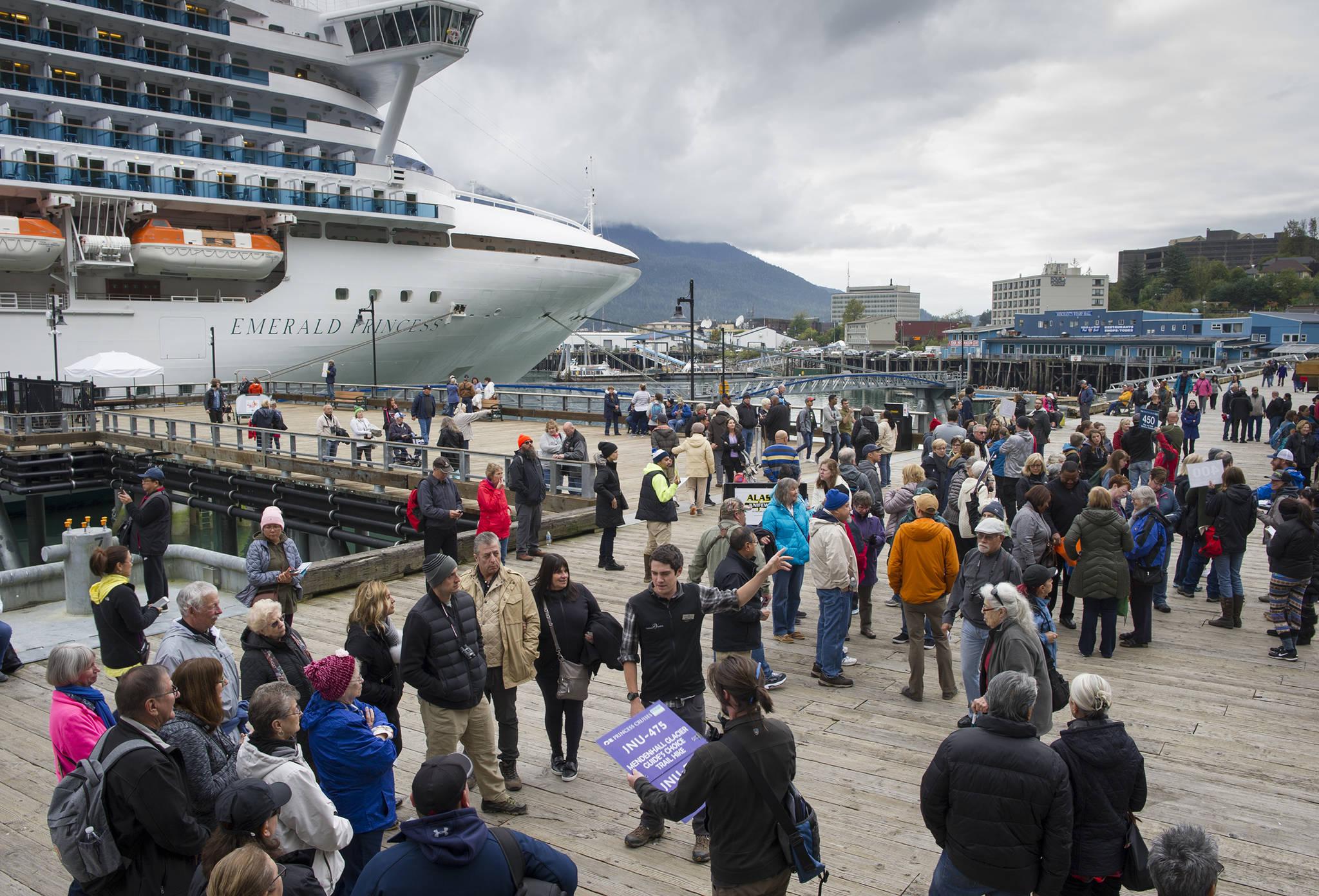 Cruise ship visitors gather for their tours on the Seawalk on Wednesday, Sept. 13, 2017. (Michael Penn   Juneau Empire File)