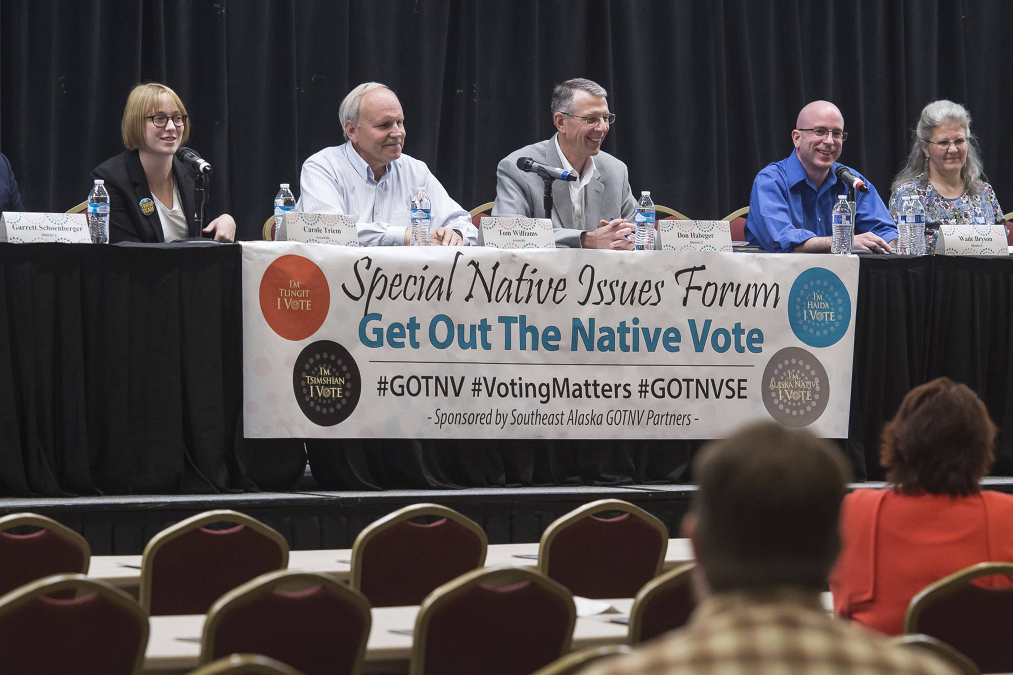 Assembly candidates answers questions during a Special Native Issues Forum at the Elizabeth Peratrovich Hall on Tuesday, Sept. 18, 2018. From left: Garrett Schoenberger, Carole Triem, Tom Williams, Don Habeger, Wade Bryson, Michelle Bonnet Hale and Loren Jones. (Michael Penn | Juneau Empire)