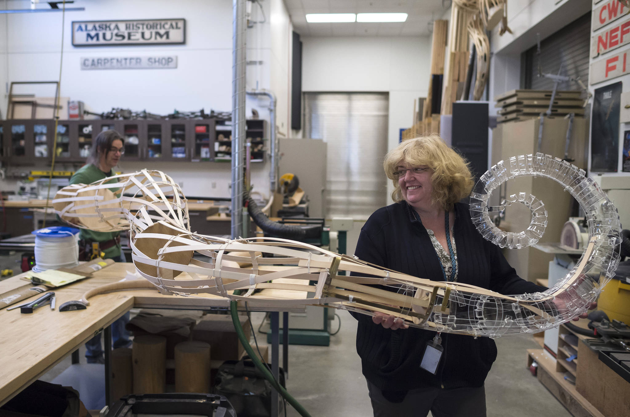 Alaska State Libraries, Archives and Museums Operation Manager Lisa Golisek-Nankerv, right, helps Museum Exhibit Specialist Aaron Elmore move one of the eight legs to a giant octopus he is building for the Museum's children's room on Monday, Sept. 17, 2018. (Michael Penn | Capital City Weekly)
