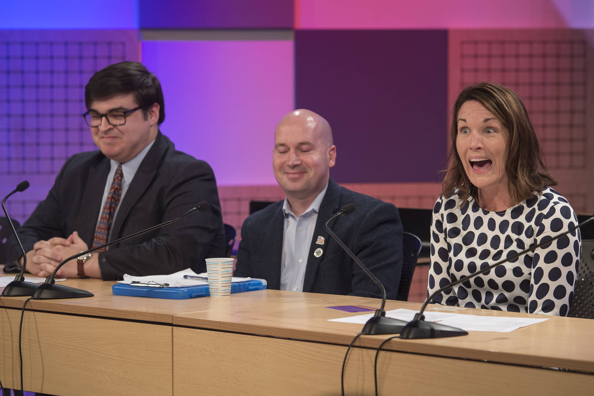 Juneau School Board candidate Elizabeth Siddon reacts to the timer's bell as she answers questions with Kevin Allen, left, Paul Kelly, center, during a candidate forum by the League of Women Voters at KTOO on Thursday, Sept. 20, 2018. (Michael Penn | Juneau Empire)