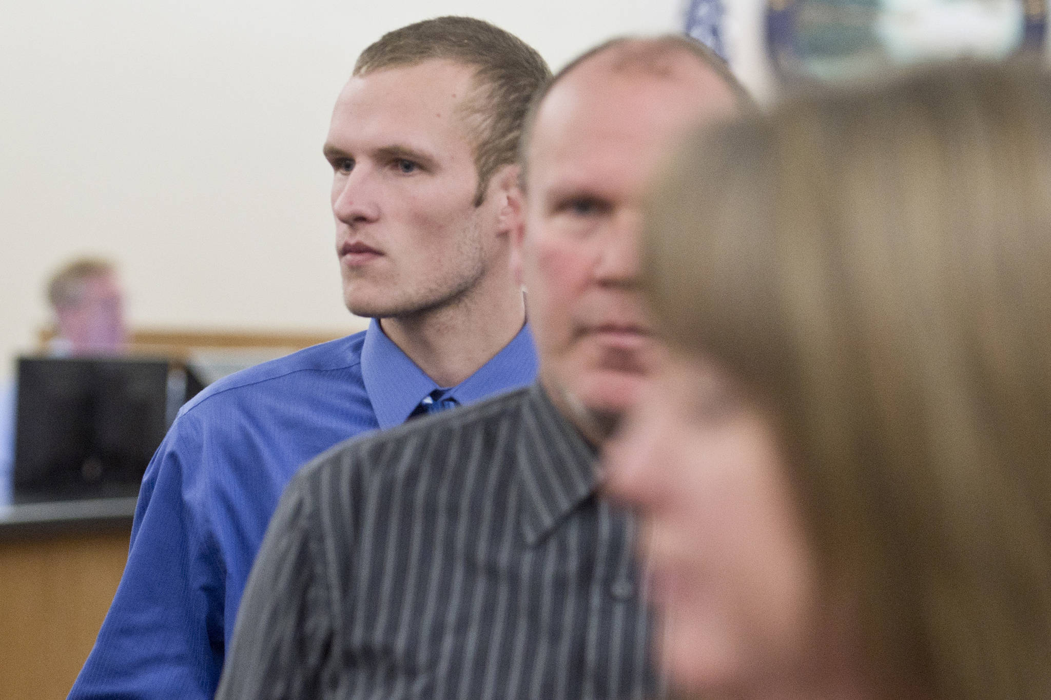 Ty Alexander Grussendorf, 22 at the time, follows his parents out of Juneau Superior Court after a trial date-setting hearing on Wednesday, March 1, 2017. (Michael Penn | Juneau Empire File)