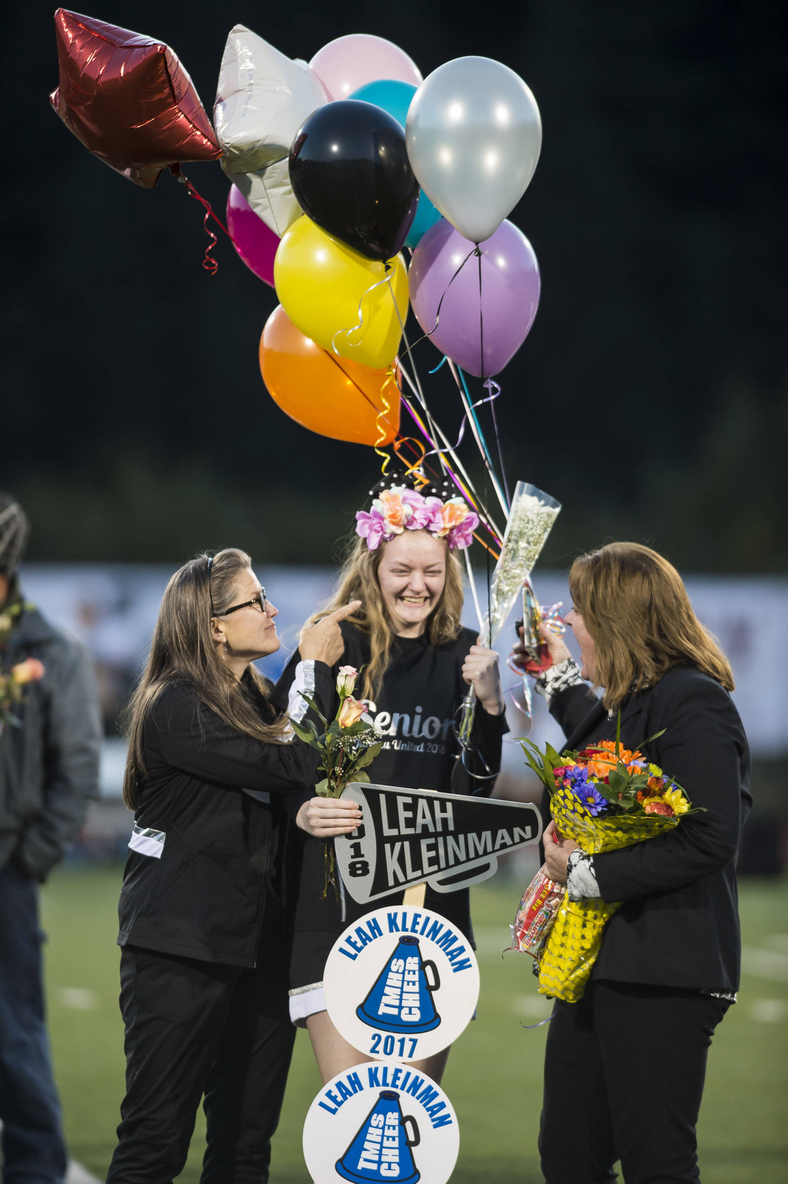 Family and friends celebrate senior night with cheerleaders and players before Juneau United's game against Colony at Thunder Mountain High School on Friday, Sept. 21, 2018. (Michael Penn | Juneau Empire)