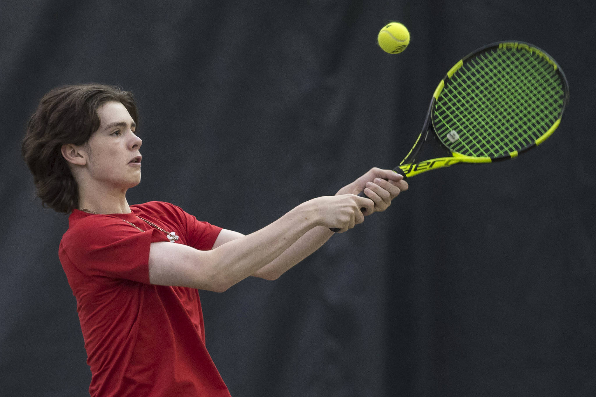 William Smoker, a junior at Juneau-Douglas High School, returns a backhand during the Regional Tennis Championships at JRC/The Alaska Club on Sunday, Sept. 23, 2018. Smoker won titles placed first in singles, doubles and mixed doubles. (Michael Penn | Juneau Empire)