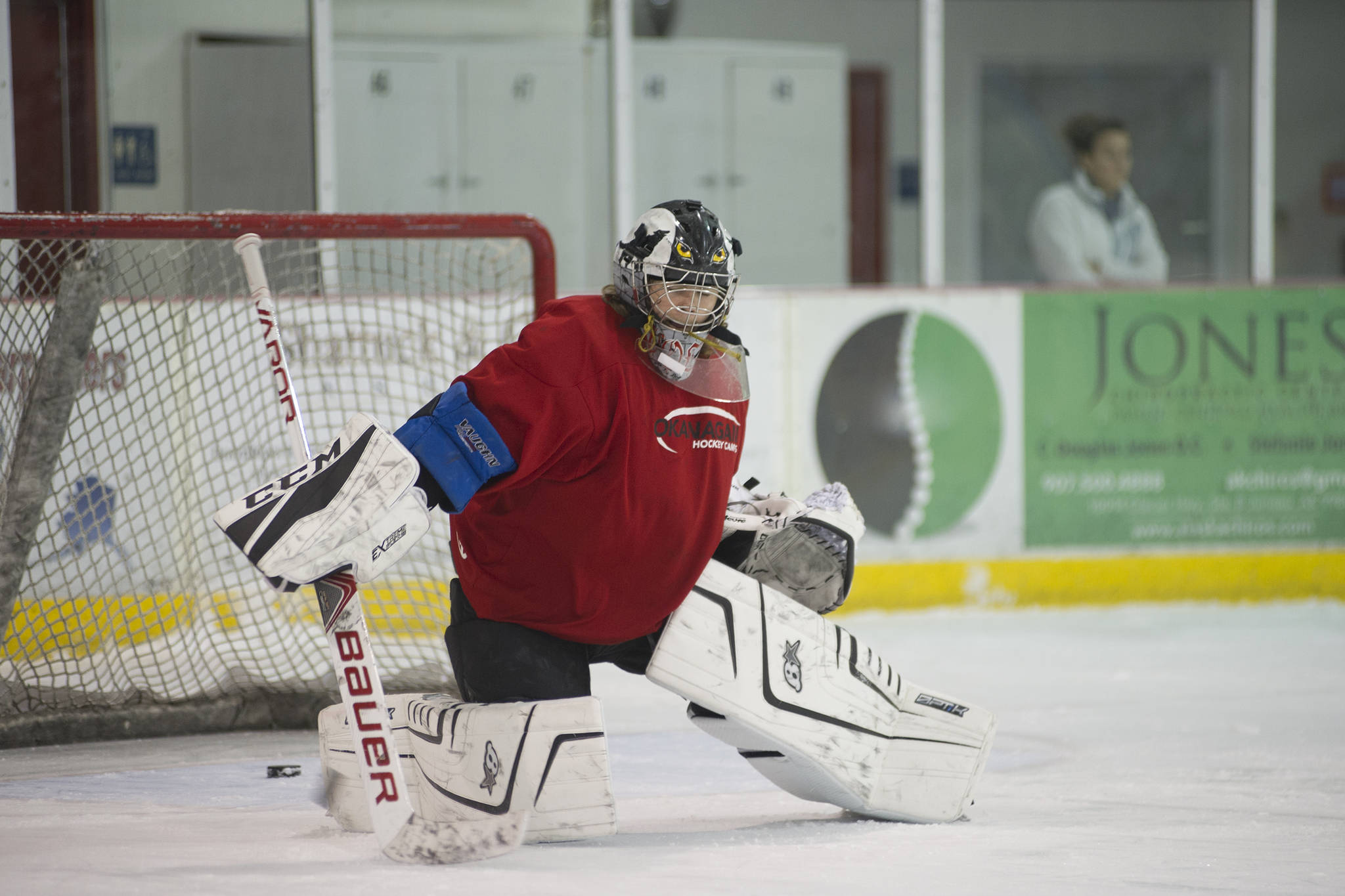 Juneau-Douglas High School senior Wolf Dostal turns aside a shot during hockey practice on Wednesday morning at Treadwell Arena. Dostal is one of three returning goaltenders on the team this season. (Nolin Ainsworth   Juneau Empire)