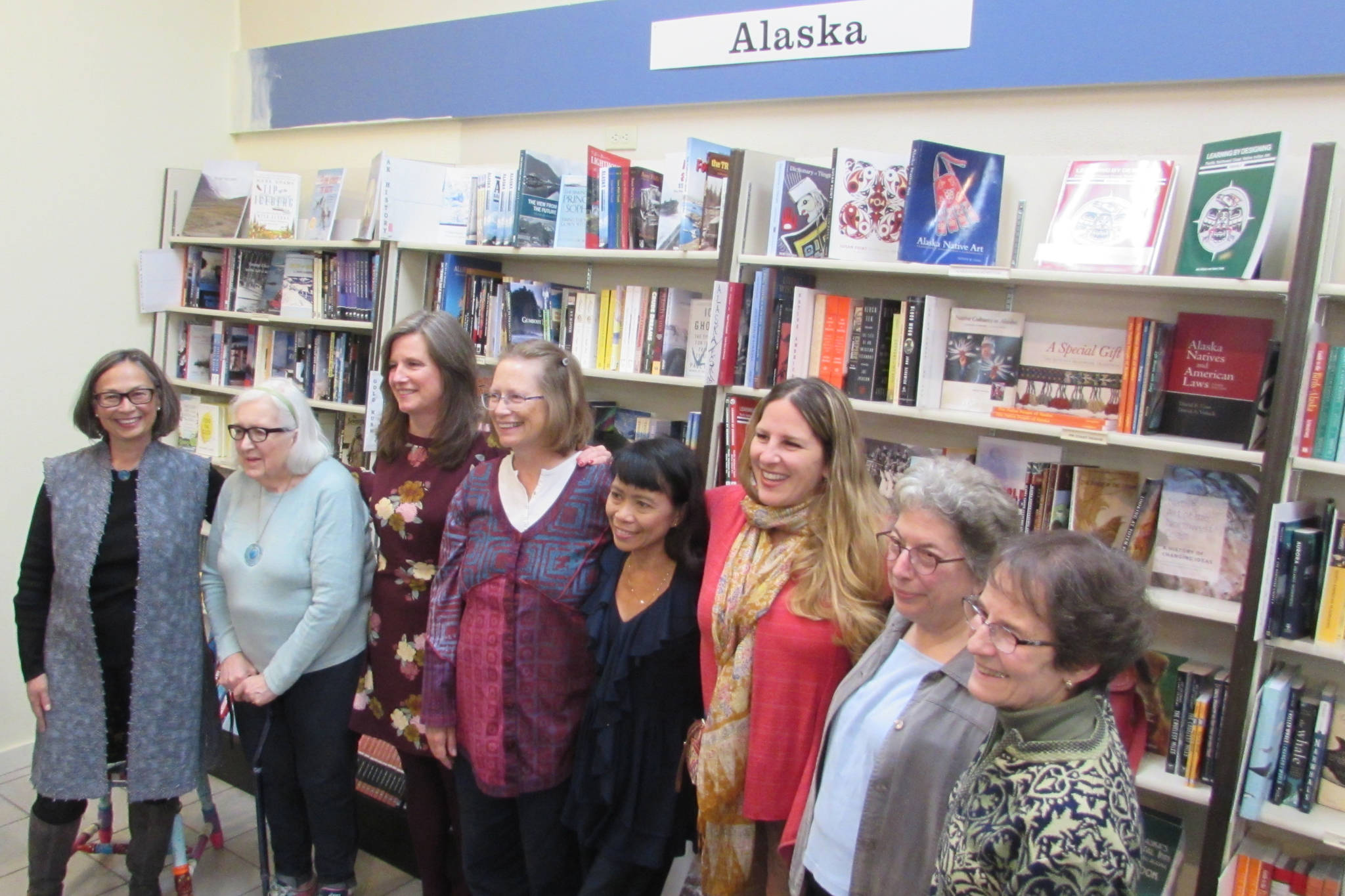 Alaska Women Speak President Carmen Davis stands with writers Mary Lou Spartz, Katie Bausler, Kate Boesser, Miriam Wagoner, Amy Pinney, Margo Waring and Dianne DeSloover at a poetry and prose reading at Hearthside Books in Nugget Mall. (Ben Hohenstatt | Capital City Weekly)