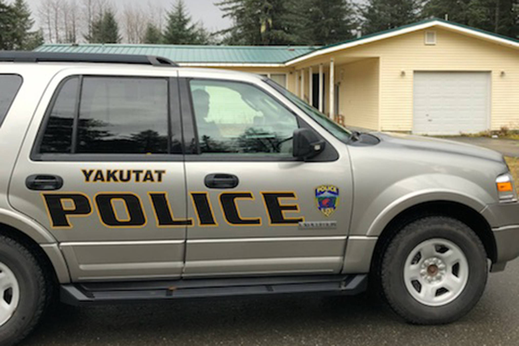 A Yakutat Borough Police Department vehicle sits in front of the site of a fatal stabbing in Yakutat on Sunday, Oct. 14, 2018. (Courtesy Photo | Yakutat Borough Police Department)