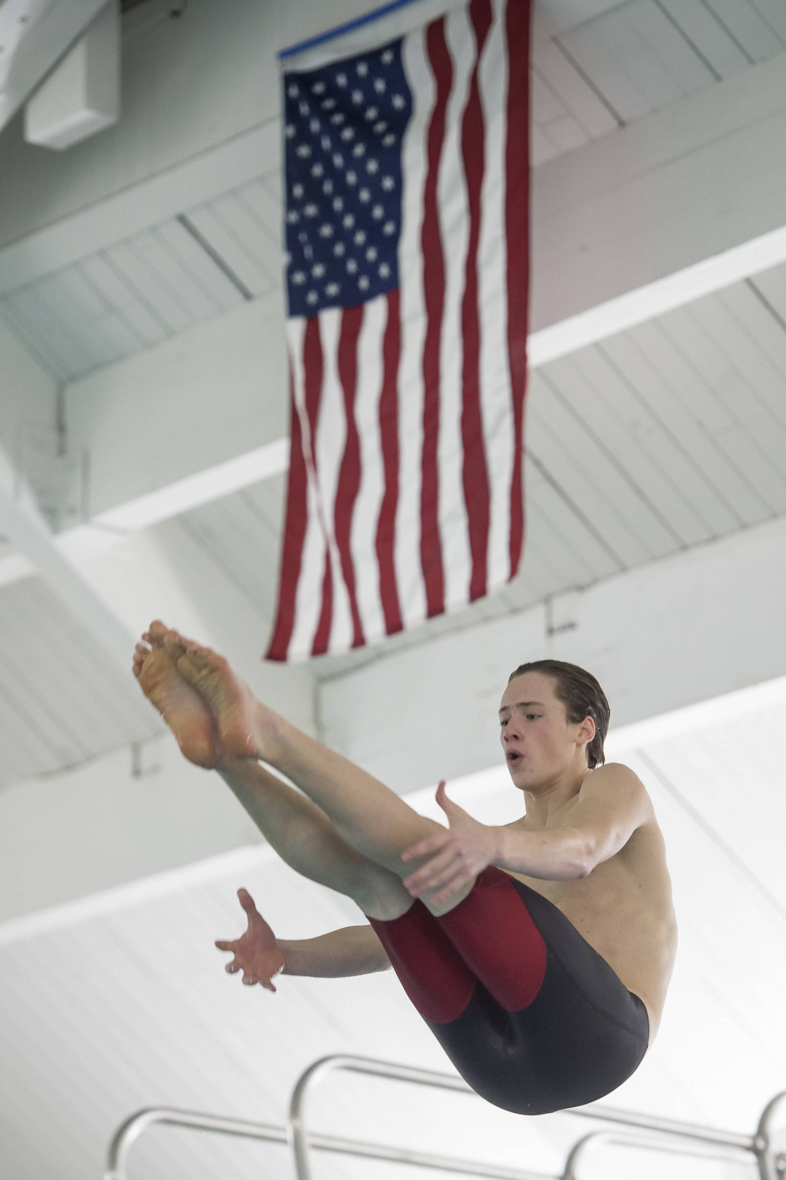 Juneau-Douglas High School senior Cian Hart practices his diving at the Augustus Brown Swimming Pool on Wednesday, Oct. 17, 2018. (Michael Penn | Juneau Empire)
