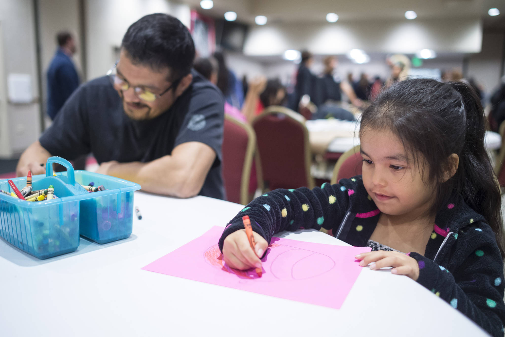 Carl Stepetin draws with his daughter, Pauline, 6, during a Celebrate Survivors gathering sponsored by Central Council Tlingit and Haida Indian Tribes of Alaska and AWARE in the Elizabeth Peratrovich Hall on Tuesday, Oct. 23, 2018. October is Domestic Violence Awareness Month. (Michael Penn | Juneau Empire)