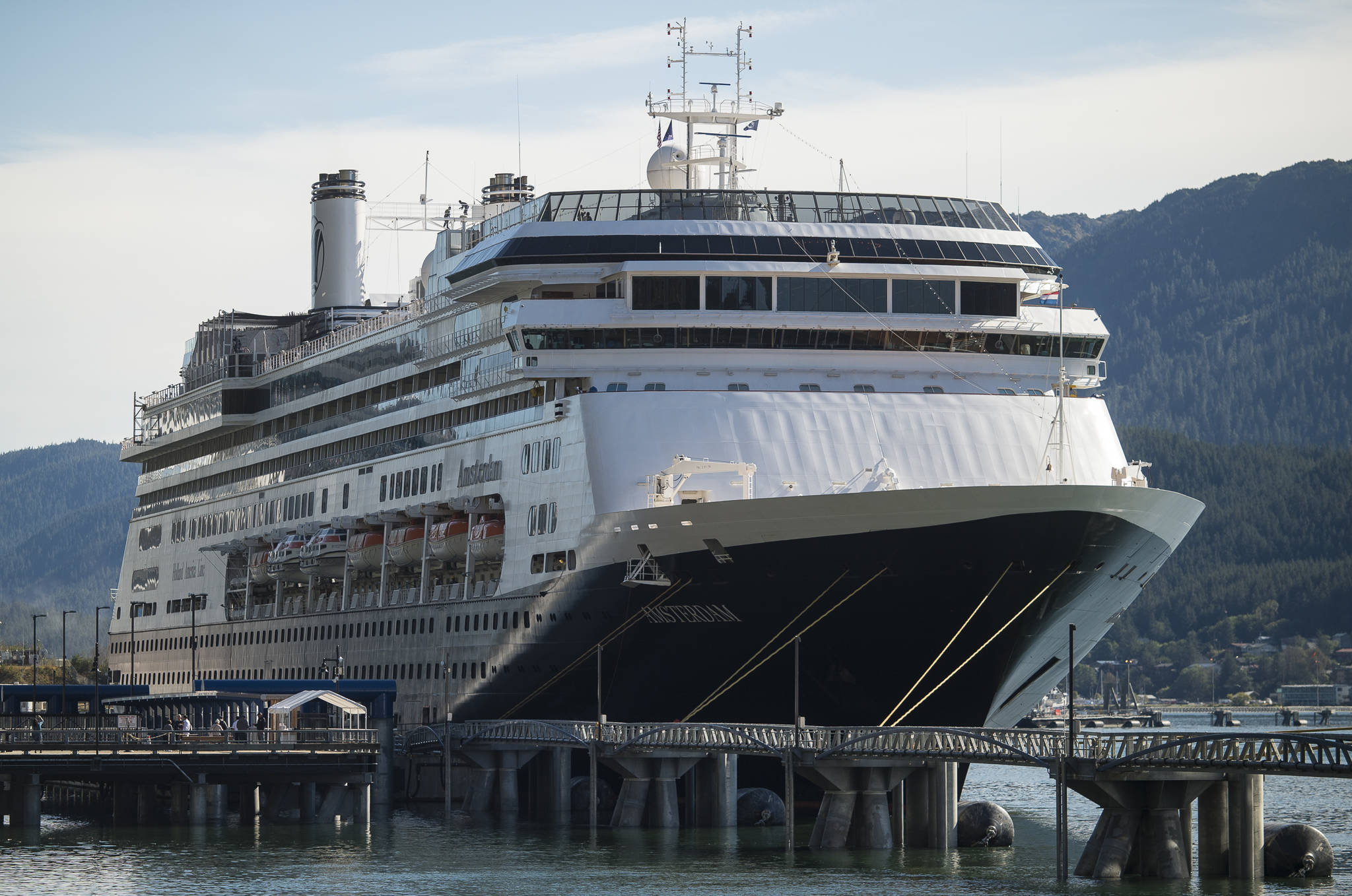 The Holland America Line ship Amsterdam sits at port in Juneau on Tuesday, Sept. 11, 2018. The Amsterdam is one of nine ships that have received Notice of Violations for air opacity issued by the Alaska Department of Environmental Conservation. (Michael Penn | Juneau Empire)