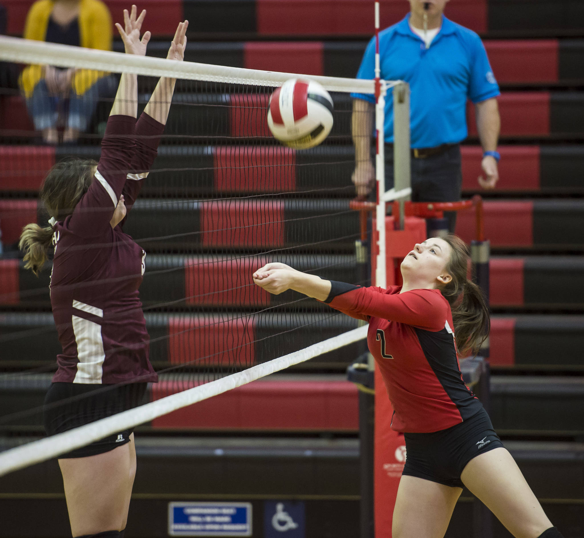 Juneau-Douglas' Kiana Potter bumps the ball up againt Ketchikan in the first round of the Region V Volleyball Championships at JDHS on Friday, Nov. 2, 2018. JDHS won 3-0 (25-13, 25-16, 25-16). (Michael Penn | Juneau Empire)