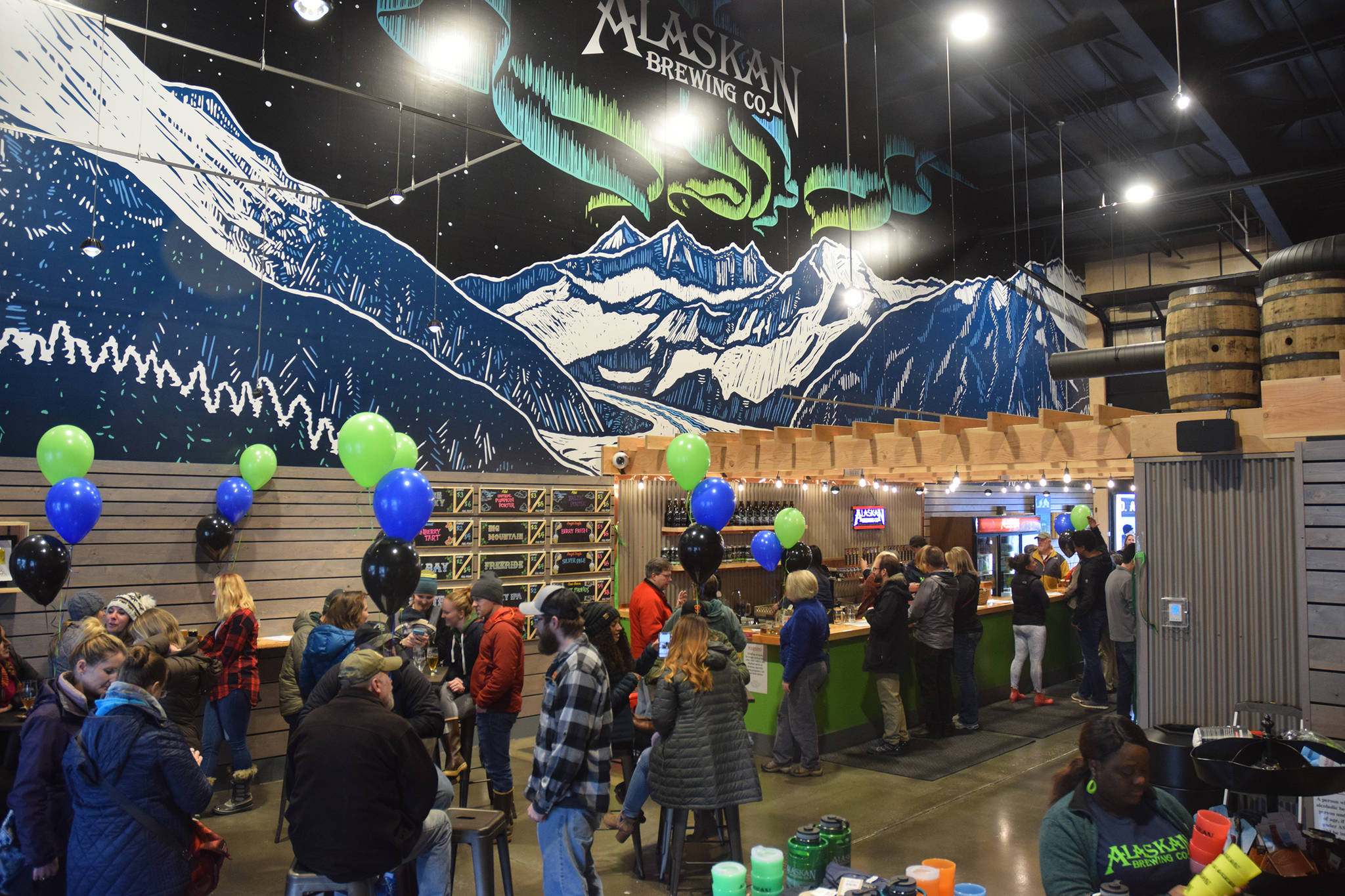 Beer lovers gather at the grand opening of Alaskan Brewing Co.'s new tasting room on Commercial Boulevard, Saturday, Nov. 3, 2018. (Kevin Gullufsen | Juneau Empire)