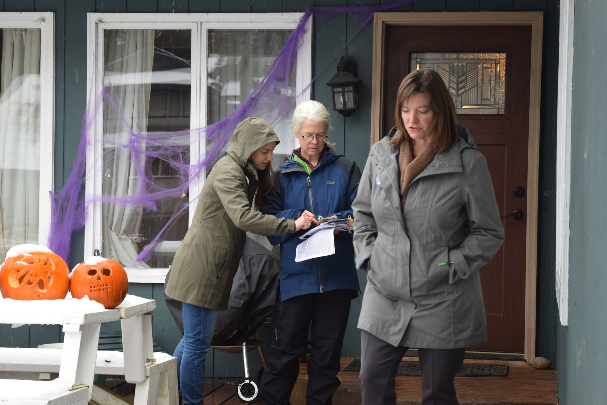 Alyse Galvin, Alaska's independent candidate for U.S. House of Representatives, leaves a home after talking with its residents Sunday, Nov. 4, 2018 in the Mendenhall Valley. Galvin was in Juneau for a final campaign stop ahead of the election. (James Brooks | Juneau Empire)
