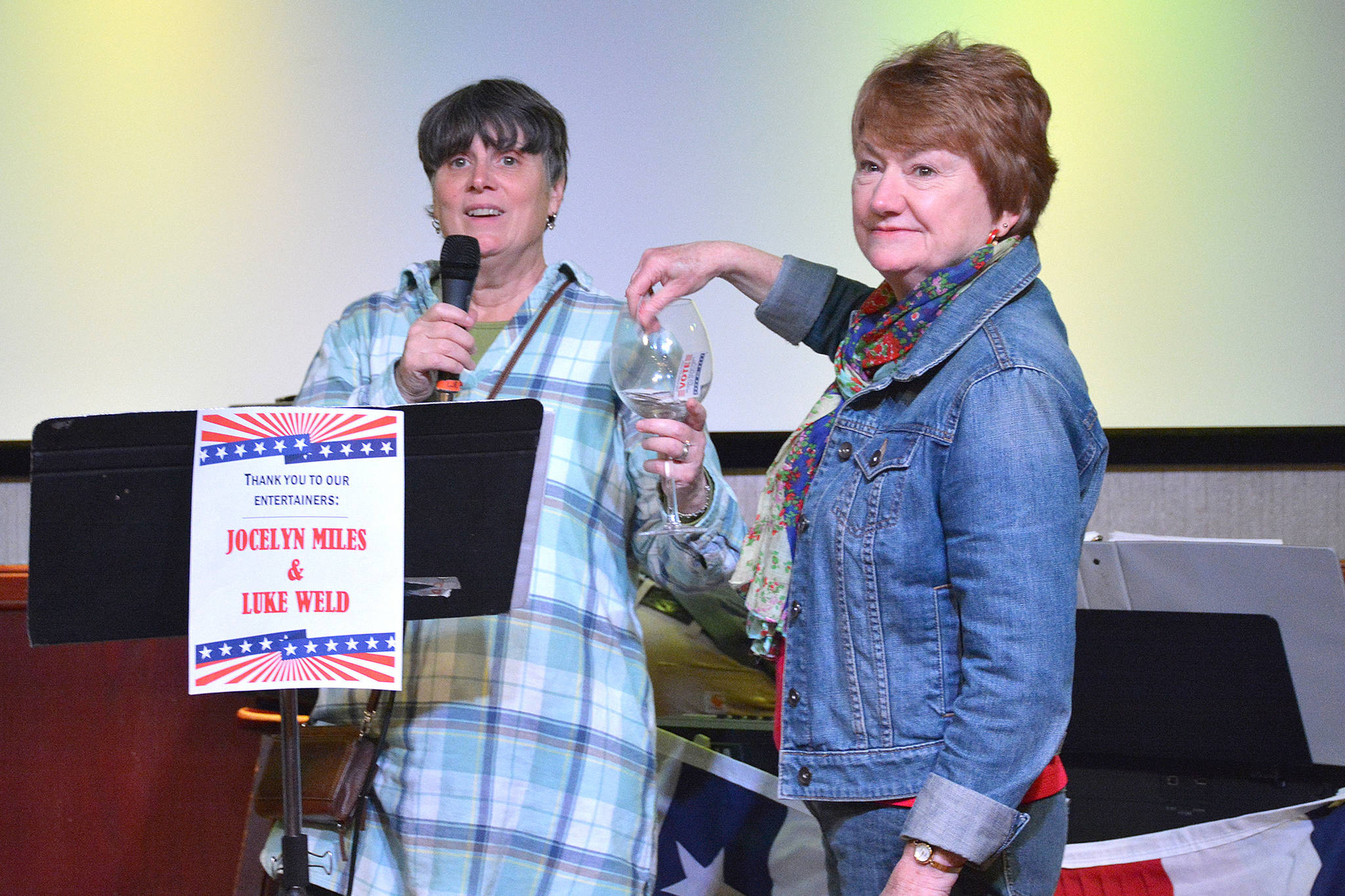 League of Women Voters of Juneau Director Judith Mitchell and Vice President Marianne Mills draw a door prize during the League's fourth annual Wine Tasting and Silent Auction Fundraiser on Oct. 5, 2018, at the Hangar Ballroom. (Courtesy Photo | Kim Andree Jones)