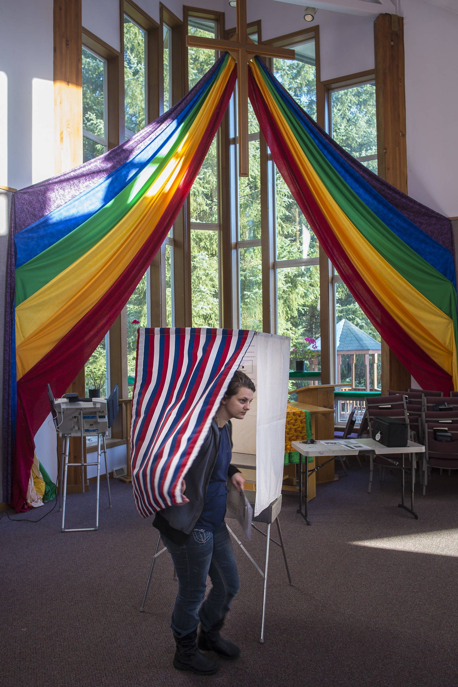 Maisi MacCabe exits a voting booth at Aldersgate United Methodist Church on Election Day, Tuesday, Nov. 6, 2018. (Michael Penn | Juneau Empire)