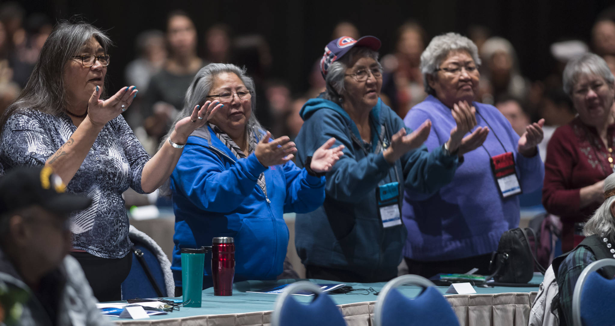 Women dance with the Tlingit Culture Language and Literacy Dance Group from Harborview Elementary School during the Voices of Our Ancestors Language Summit at Centennial Hall on Tuesday, Nov. 13, 2018. (Michael Penn | Juneau Empire)
