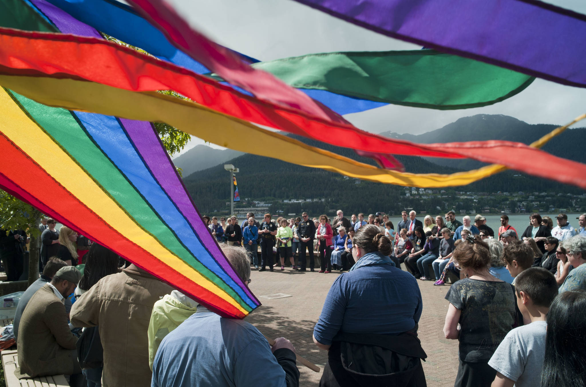 In this June 2016 photo, Juneau residents attend a vigil at Marine Park. Tuesday evening there will be a candlelight vigil and documentary screening in recognition of Trans Day of Remembrance, a national event held in light of the violence transgender and gender nonconforming people face. (Michael Penn | Juneau Empire File)