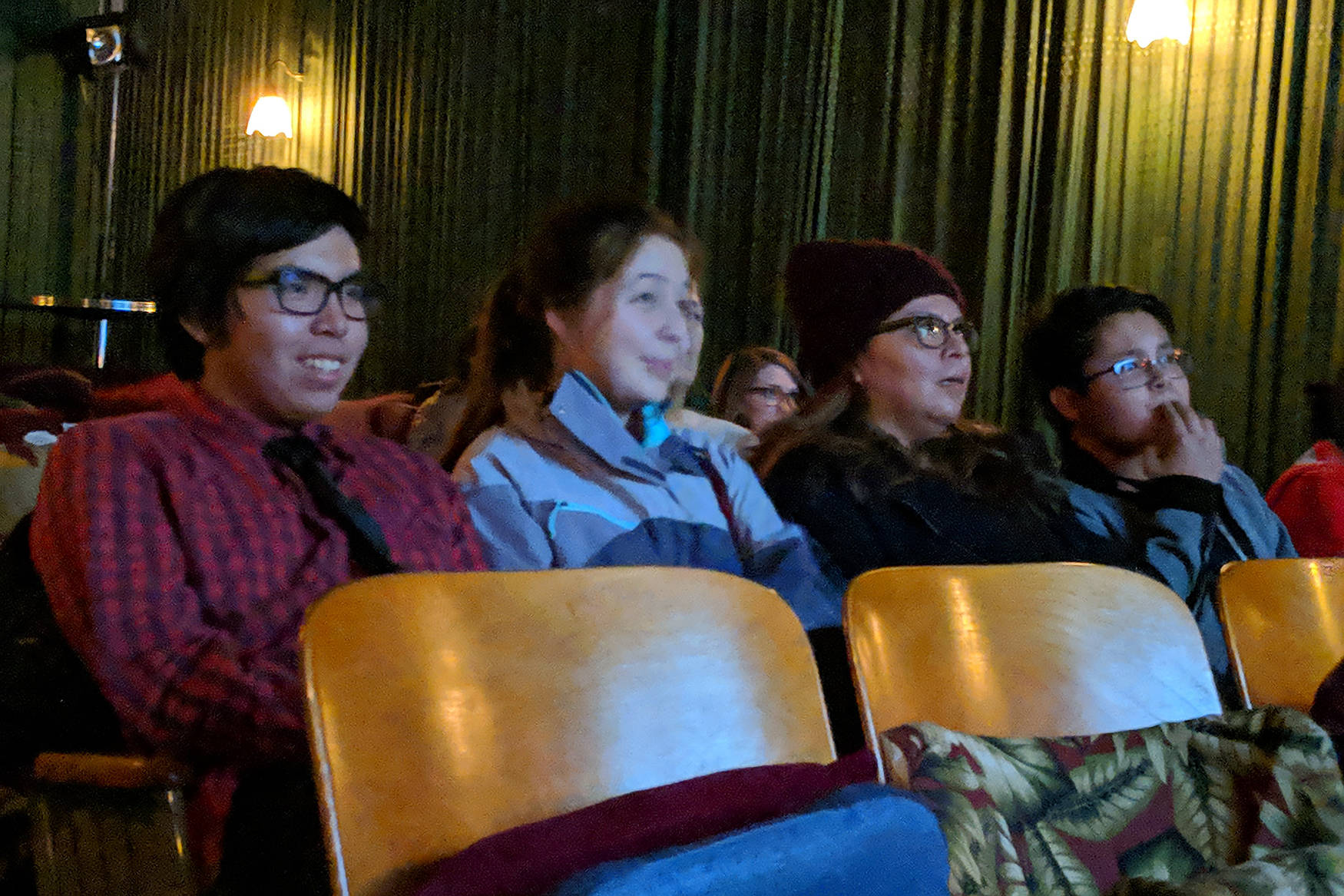 "Michael Martin Jr., whose short film ""Adapt"" screened during a showing of ""Our Alaskan Stories"" watches his movie with his girlfriend, Annie Masterman; mom, Michelle Martin; and brother, Micheel Martin at Gold Town Nickelodeon Saturday, Nov. 17. (Ben Hohenstatt 
