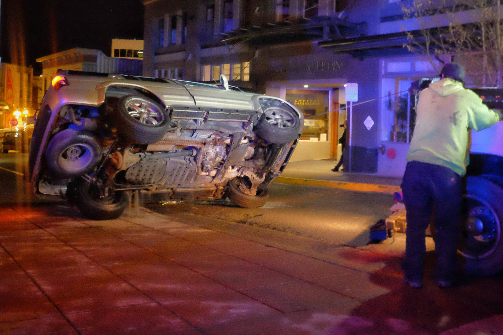 An SUV sits on its side after colliding with a concrete planter at the corner of Seward Street and Second Street on Thursday, Jan 18. The driver and sole passenger were taken to the hospital for injuries that were not life-threatening. (Courtesy photo | Jessie Herman-Haywood)