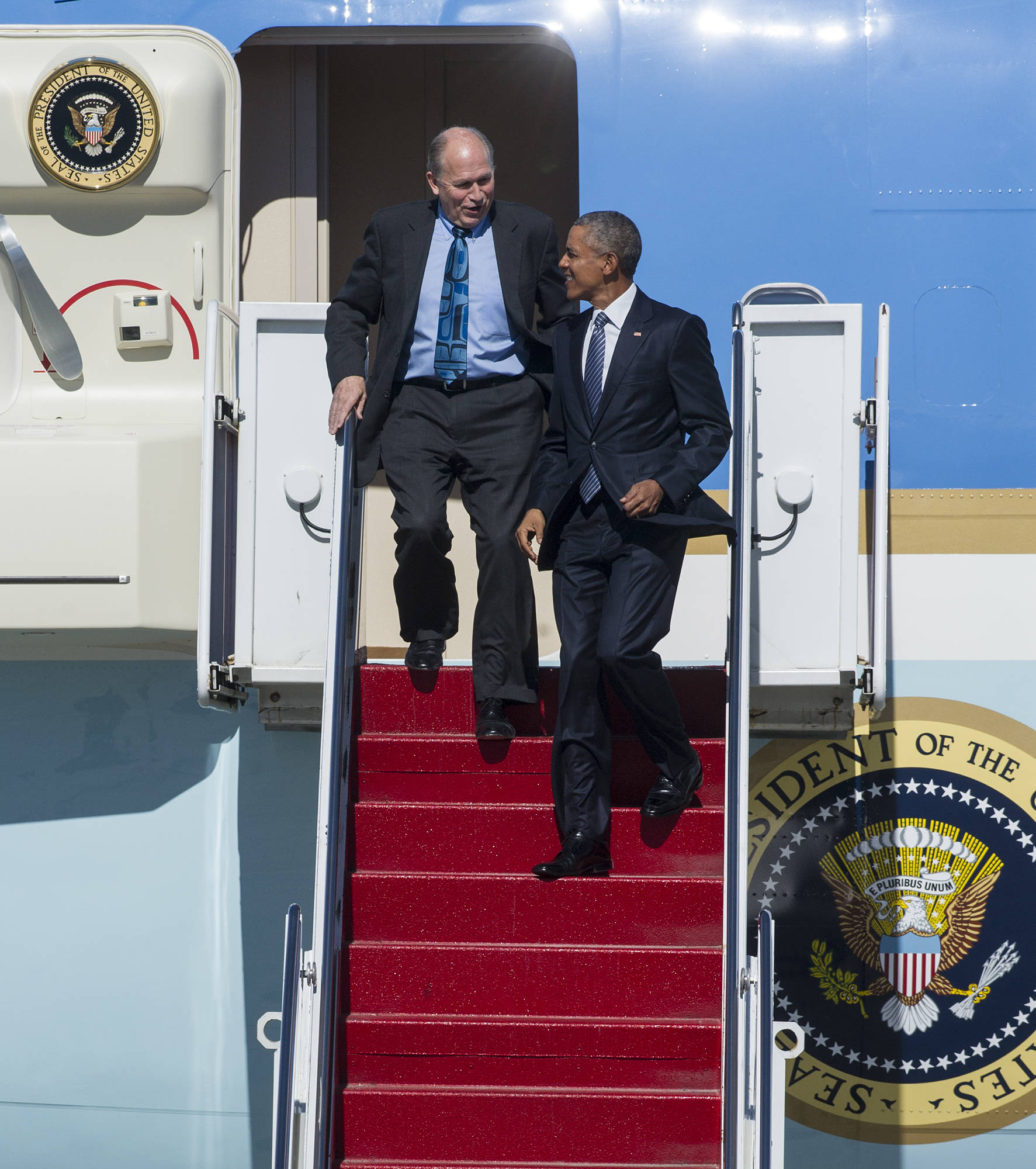 In this Aug. 31, 2015 photo, President Barack Obama arrives on Air Force One at Joint Base Elmendorf-Richardson in Anchorage with Gov. Bill Walker. (Michael Penn | Juneau Empire File)