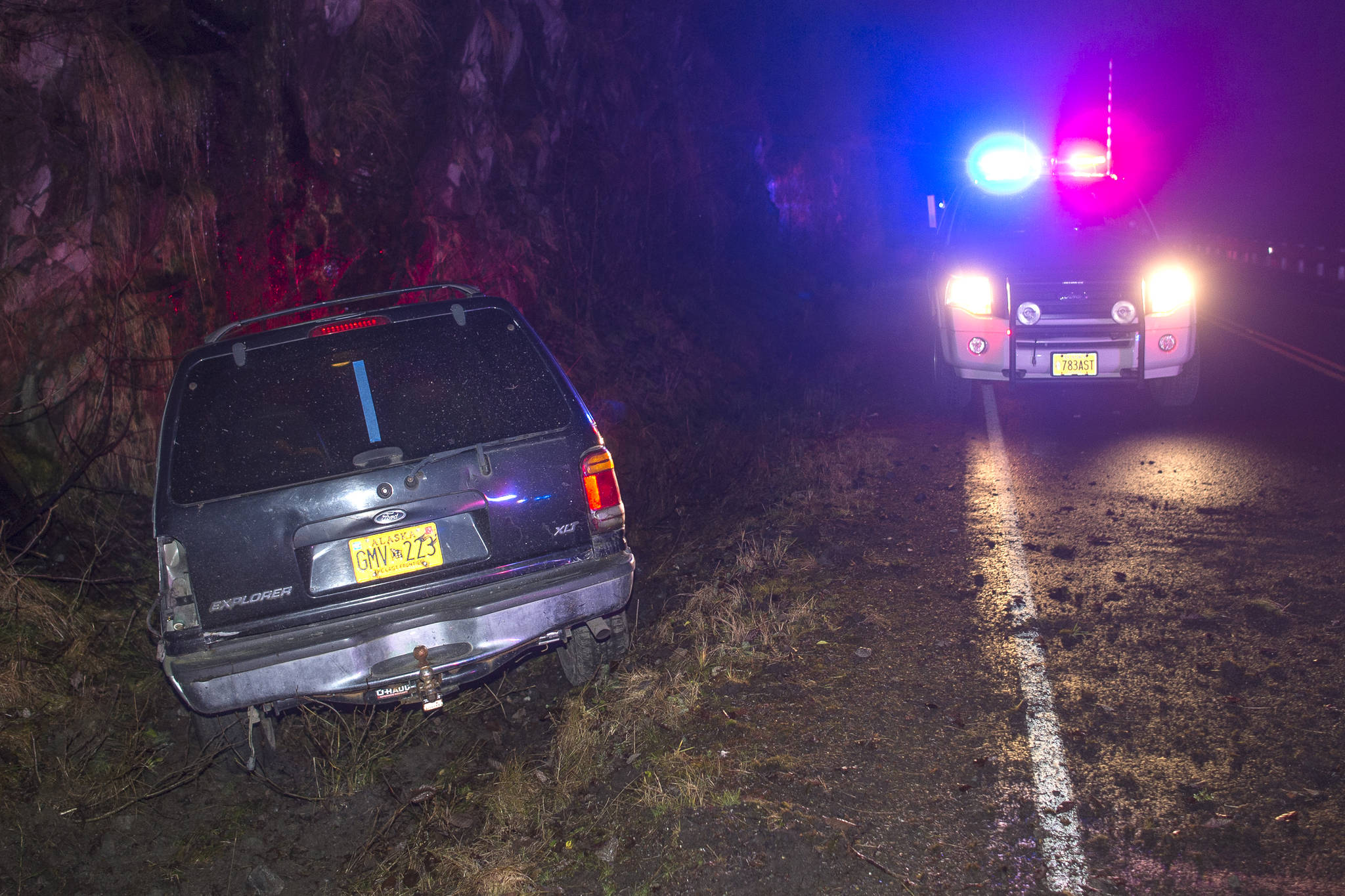 A vehicle sits in a ditch along Thane Road after the driver fell asleep on Tuesday, Nov. 27, 2018. The driver was taken to Bartlett Regional Hospital. (Michael Penn | Juneau Empire)
