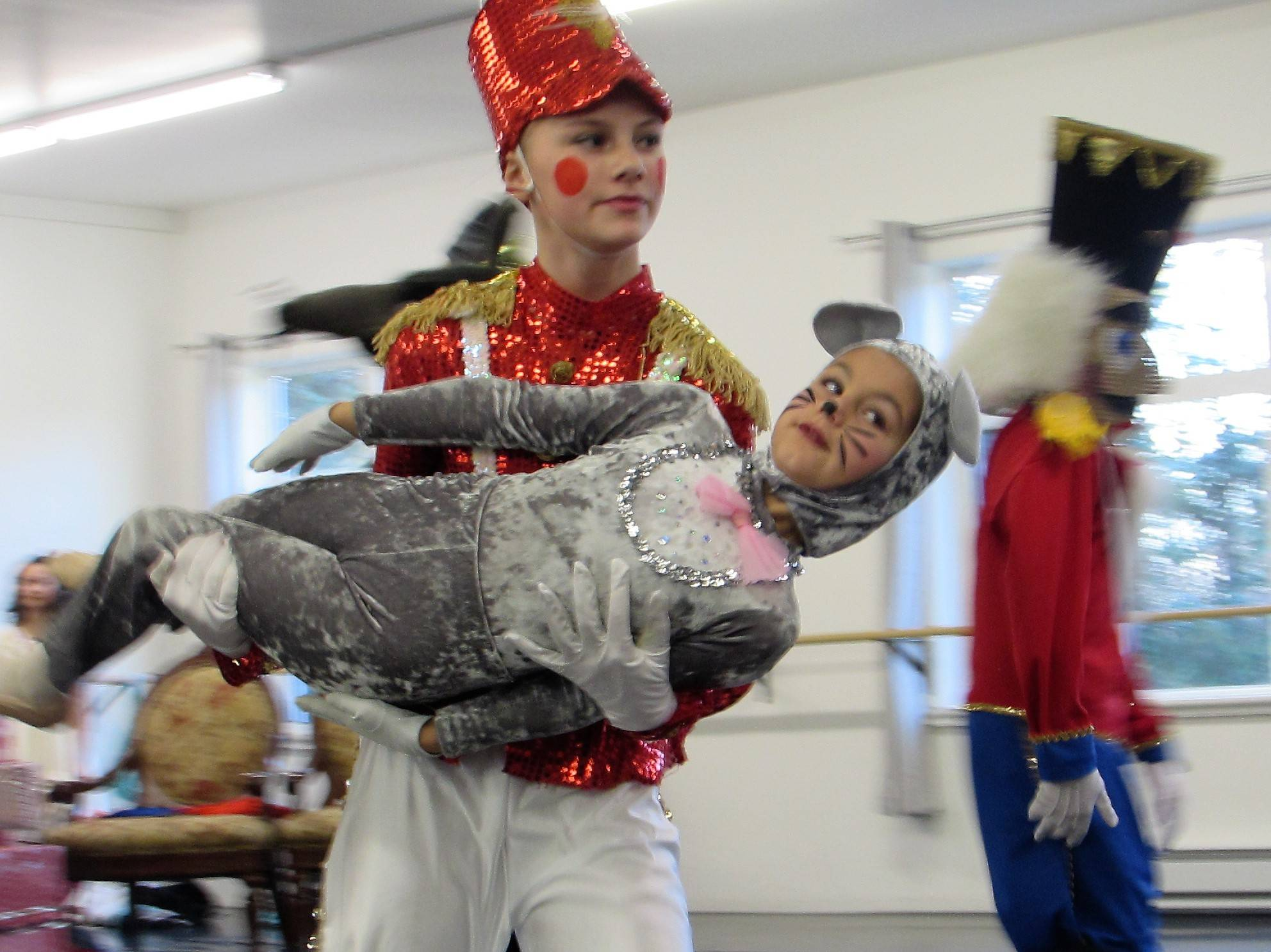 "Lead Soldier Elizabeth Eriksen runs off with mouse Autumn Katasse during rehearsal Saturday, Dec.1 for ""The Nutcracker.""(Ben Hohenstatt 