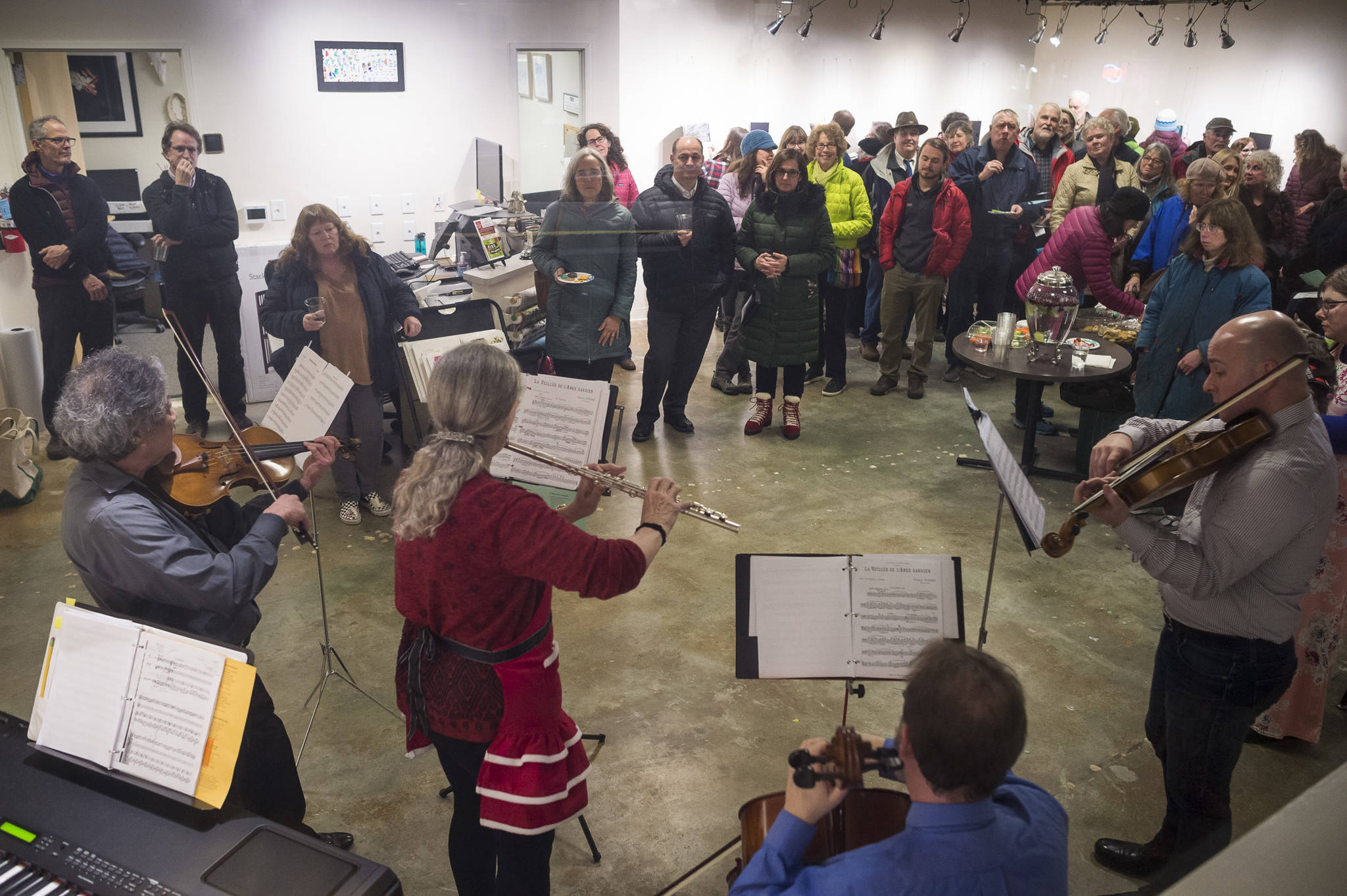 """SaraNaTa"", made up of Sara Radke Brown, Steve Tada, Nancy Nash, Andrew Schirmer, Jetta Whittaker, David Seid and John Staub perform Baroque tunes and carols at The Canvas during Gallery Walk on Friday, Dec. 7, 2018. (Michael Penn 