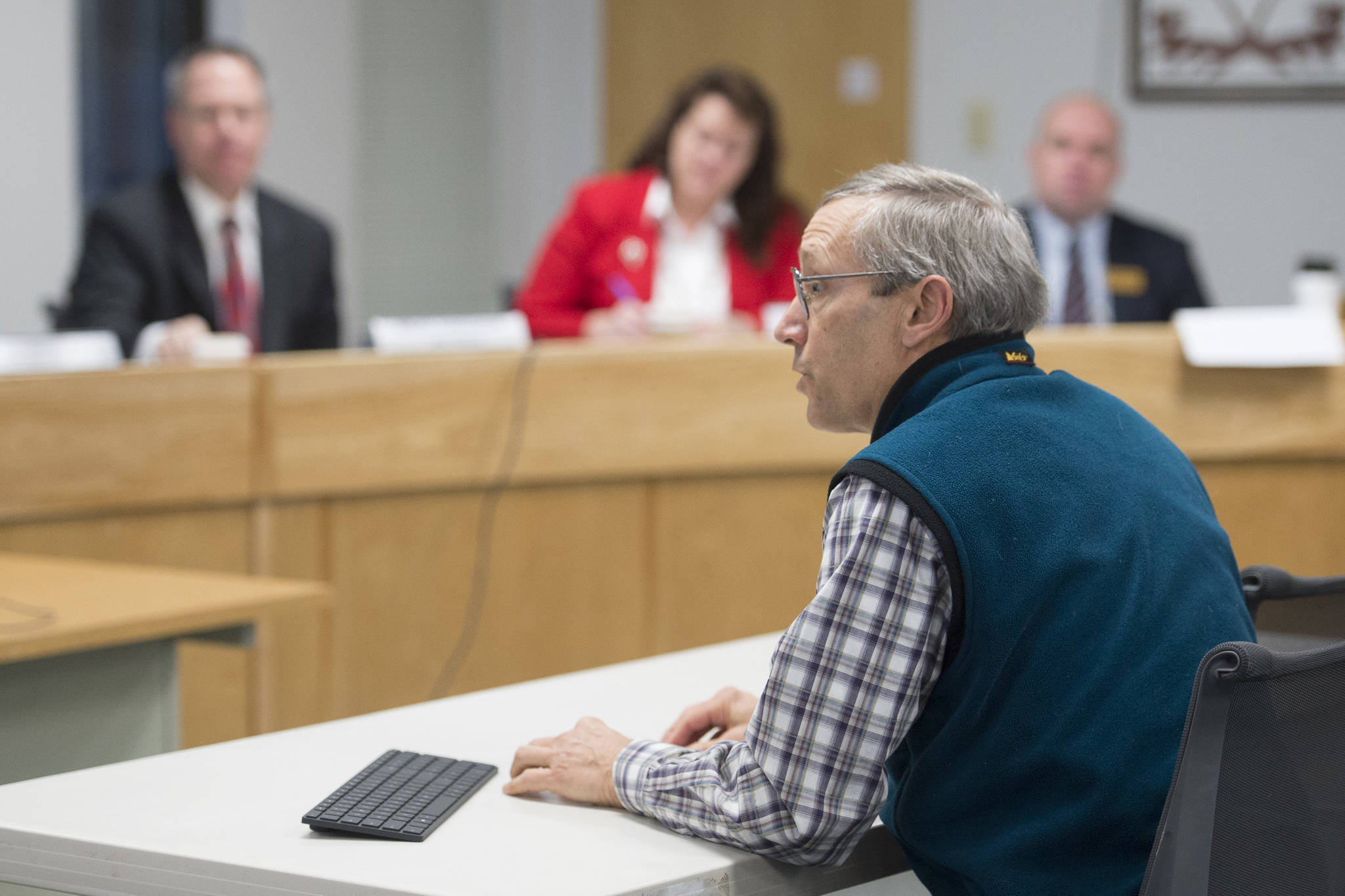 Doug Woodby, co-chair of climate action group @350 Juneau, speaks to the Alaska Permanent Fund Corporation's Board of Trustees during its quarterly meeting in Juneau on Tuesday, Dec. 11, 2018. The local chapter of the national environmental group has been asking the trustees to divest from fossil fuel investments.