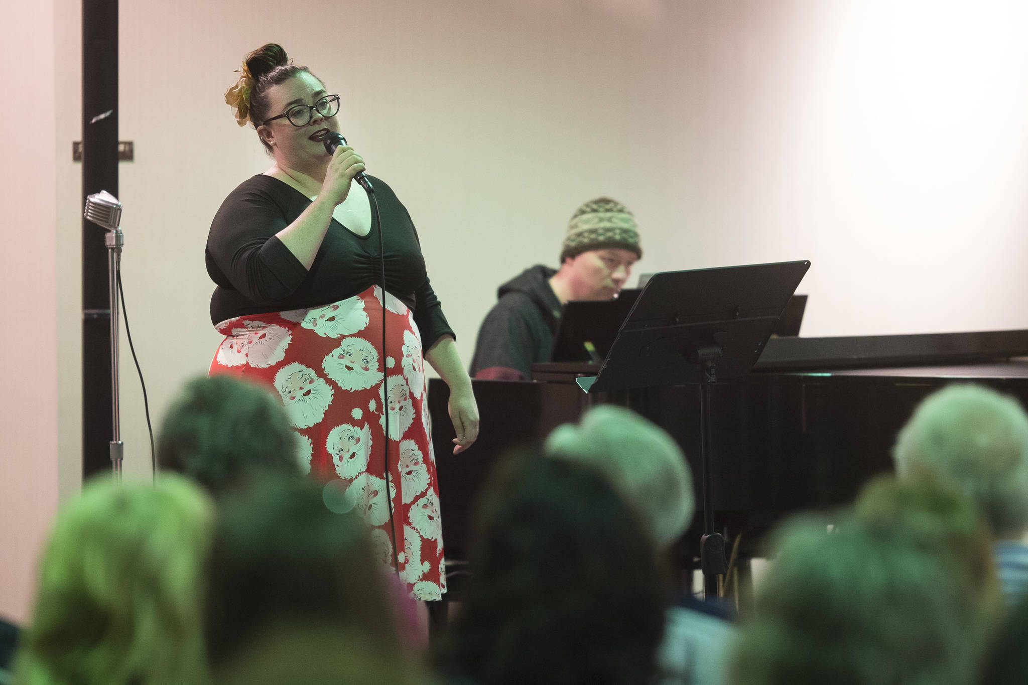 Juneau Cabaret singer Anneka Knotts Morgan sings for Juneau residents as she is accompanied by Luke Weld during the third annual Holiday Extravaganza at Centennial Hall on Wednesday, Dec. 19, 2018. (Michael Penn | Juneau Empire)