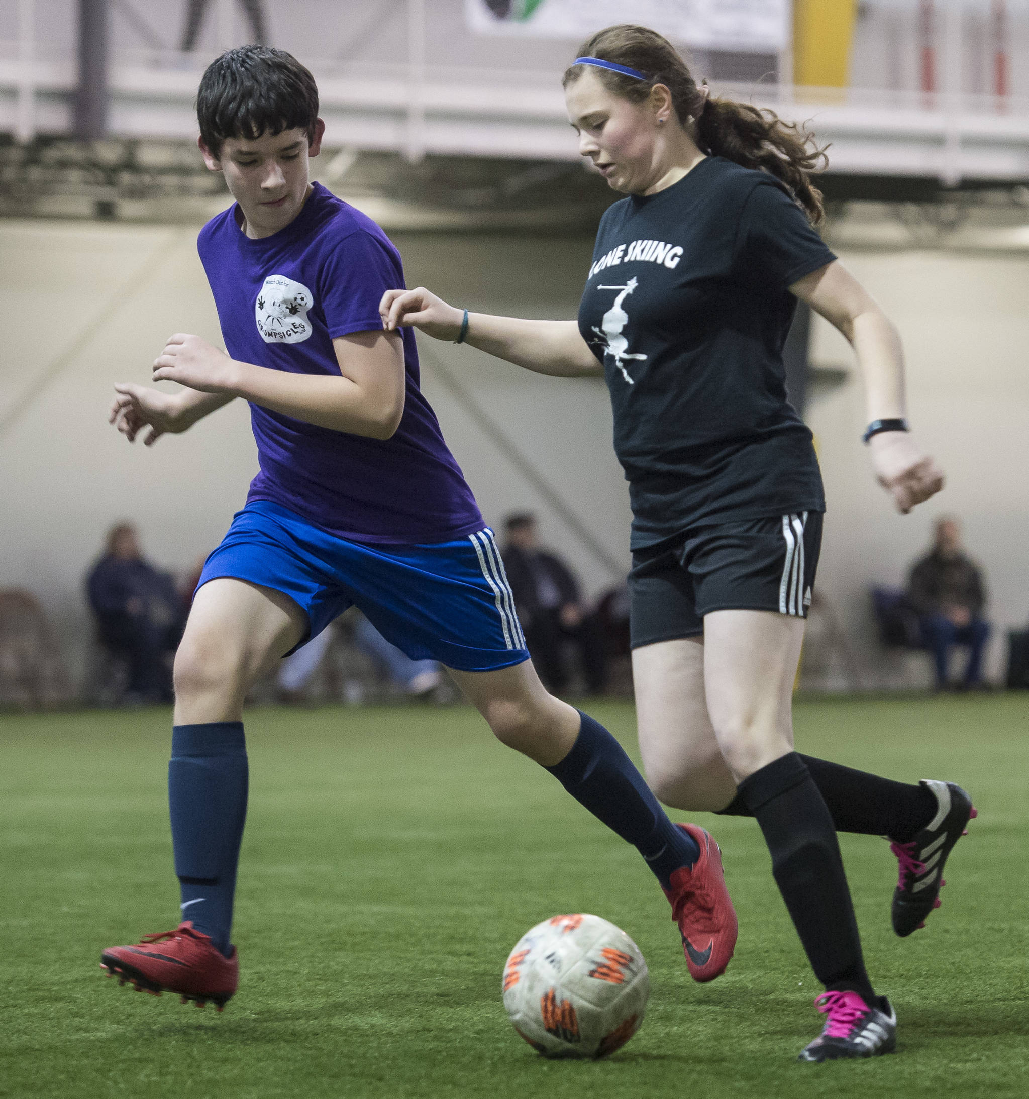 Grumpsicles play against Gone Skiing at the annual Holiday Cup Soccer Tournament at the Wells Fargo Dimond Park Field House on Wednesday, Dec. 26, 2018. (Michael Penn   Juneau Empire)