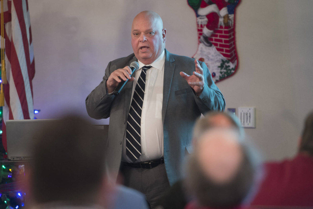 Chuck Wimberly, President & CEO of Goldbelt Inc., speaks to the Juneau Chamber of Commerce during its weekly luncheon at the Moose Lodge on Thursday, Dec. 6, 2018. At the time he said he was confident Goldbelt would land the billion-dollar federal contract the Alaska Native corporation announced it was awarded Thursday, Dec. 27. (Michael Penn | Juneau Empire)